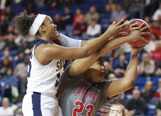 Sanford's Amiya Carroll (left) goes for a rebound against Conrad's Ja'Nylah Whittlesey in the first half of a DIAA state tournament semifinal at the Bob Carpenter Center Wednesday.