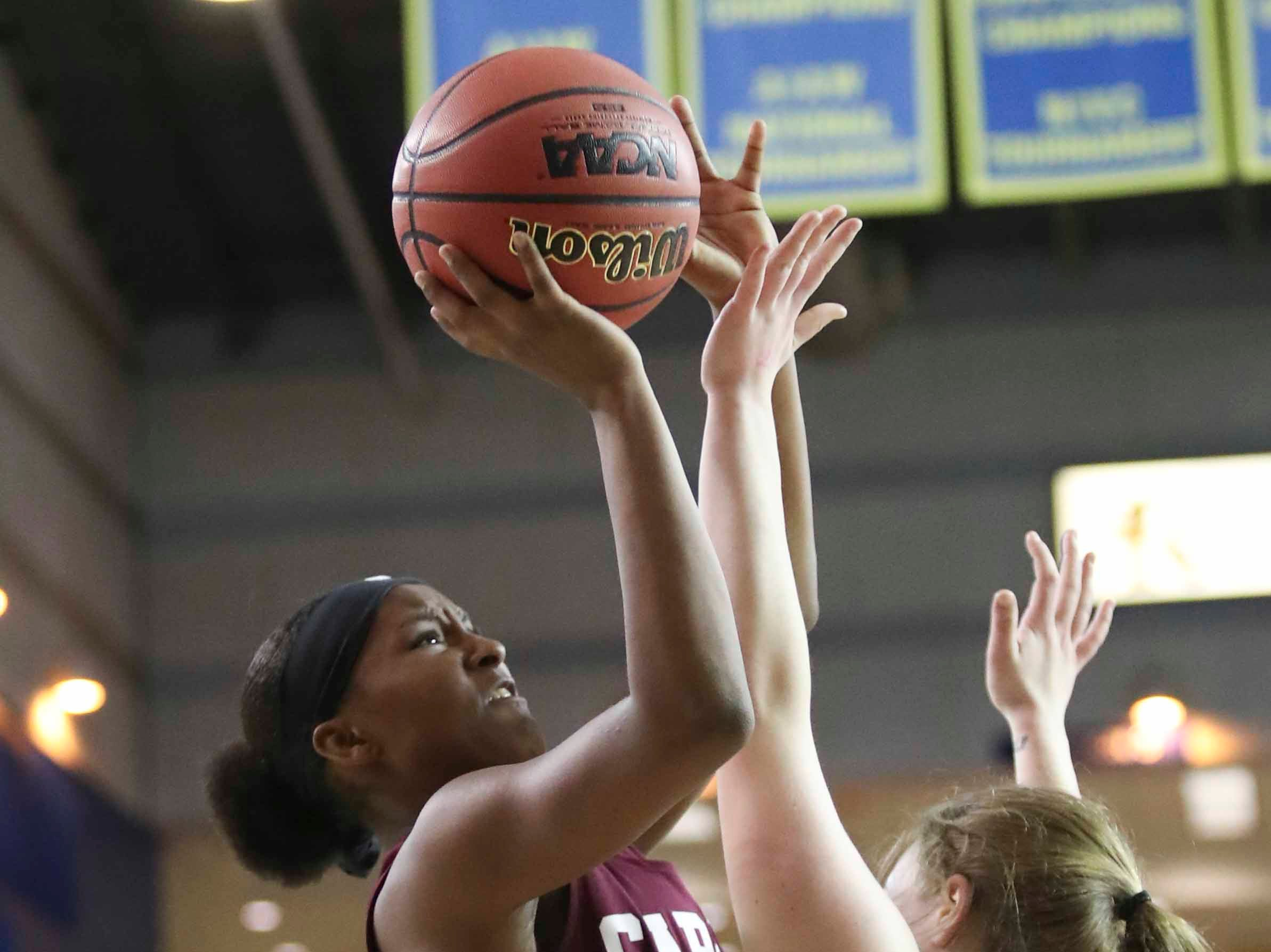 Caravel's Sasha Marvel (left) shoots against St. Elizabeth's Rory Ciszkowski in the second half of Caravel's 67-58 win in a DIAA state tournament semifinal at the Bob Carpenter Center Wednesday.
