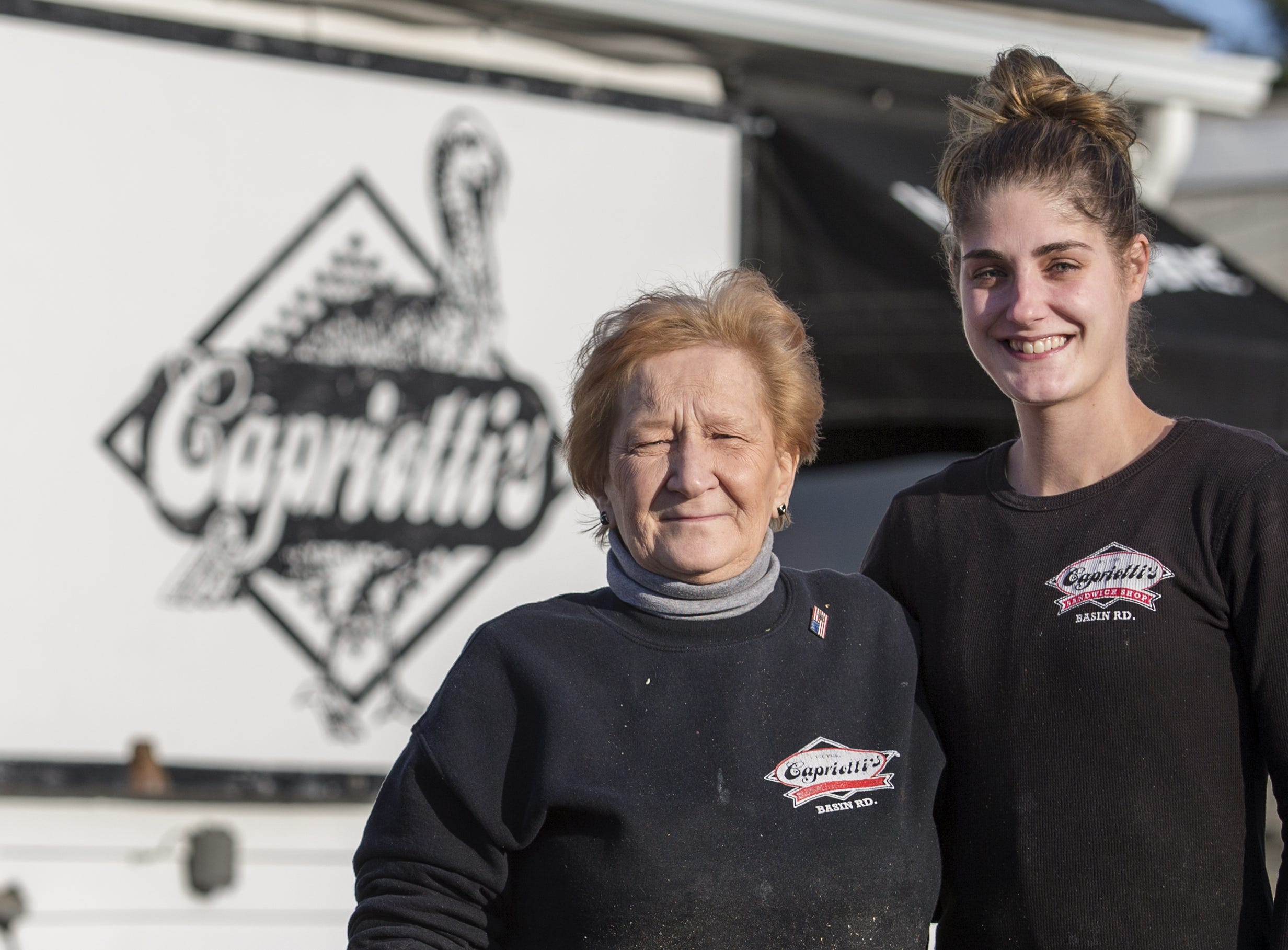 Margaret Smith (left) and Traci Williamson pose for a portrait outside Capriotti's along Basin Road in New Castle in 2016.