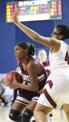 Caravel's Sasha Marvel (left) moves against St. Elizabeth's Ardavia Lee in the second half of Caravel's 67-58 win in a DIAA state tournament semifinal at the Bob Carpenter Center Wednesday.