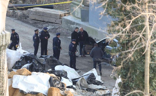 Wilmington police investigate a possible shooting under the Washington Street Bridge in Brandywine Park March 7.