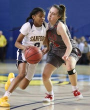 Sanford's Lauren Park (left) drives against Conrad's Alyssa Faville in the first half of a DIAA state tournament semifinal at the Bob Carpenter Center Wednesday.