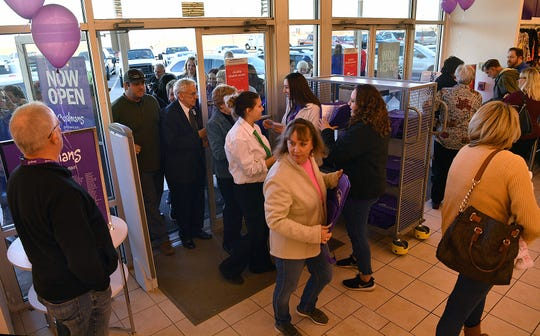 The first customers stream in the doors Wednesday evening at the new Gordmans store in Burkburnett.