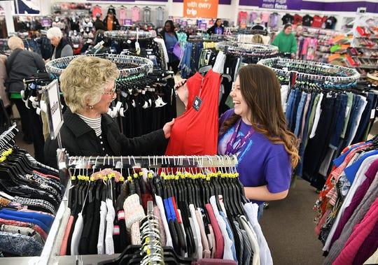 Gail Brunson, left, talks with Gordmans sales associate Meagan Walker during the store's grand opening Wednesday evening in Burkburnett.