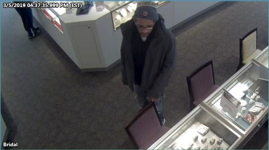 The ZPD is asking for the public's help in identifying this individual who fled from Kay Jewelers with merchandise on Tuesday.