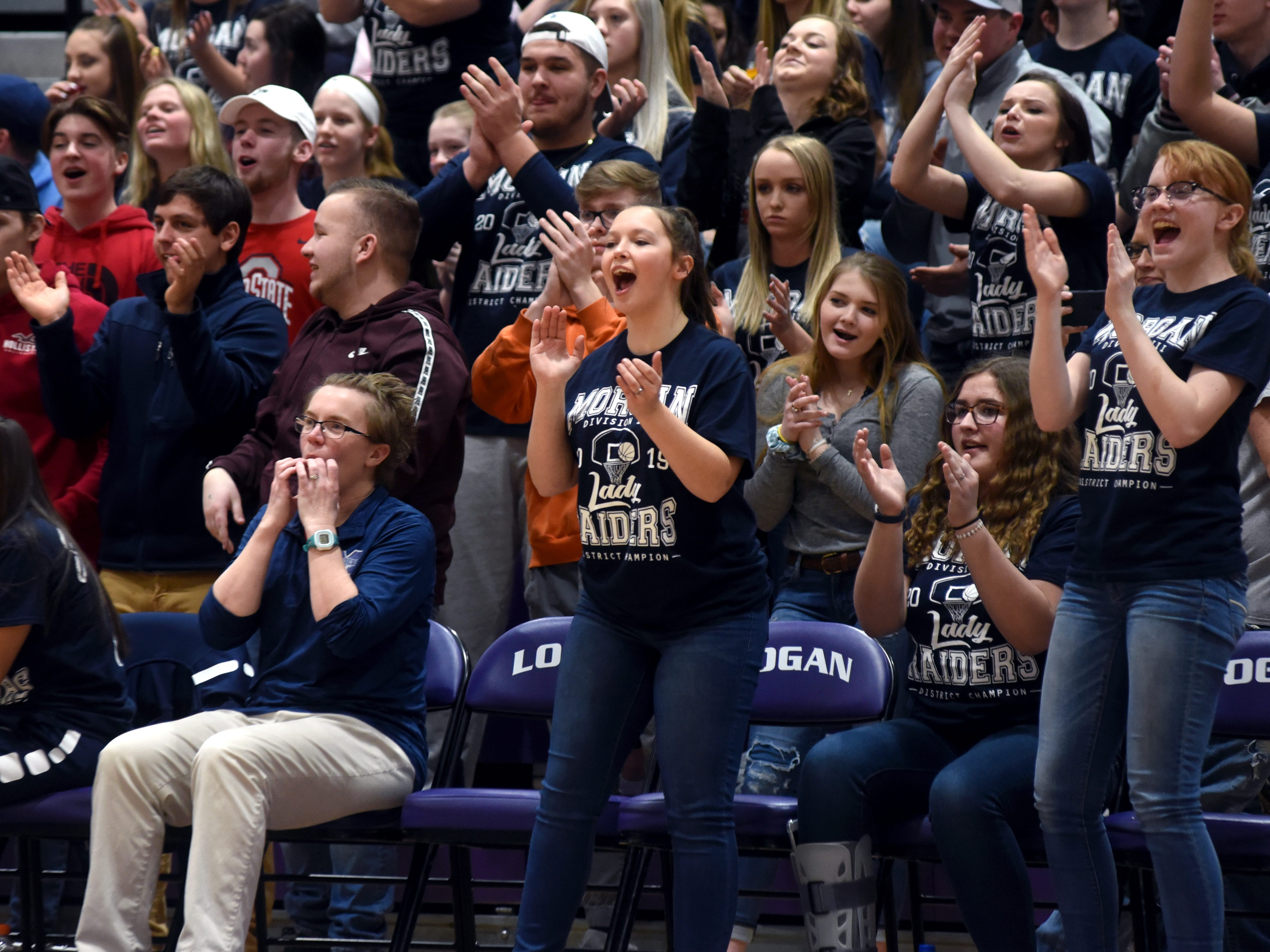 Fans celebrate during Morgan's 56-55 loss to Wheelersburg in a Division III regional semifinal at Logan.
