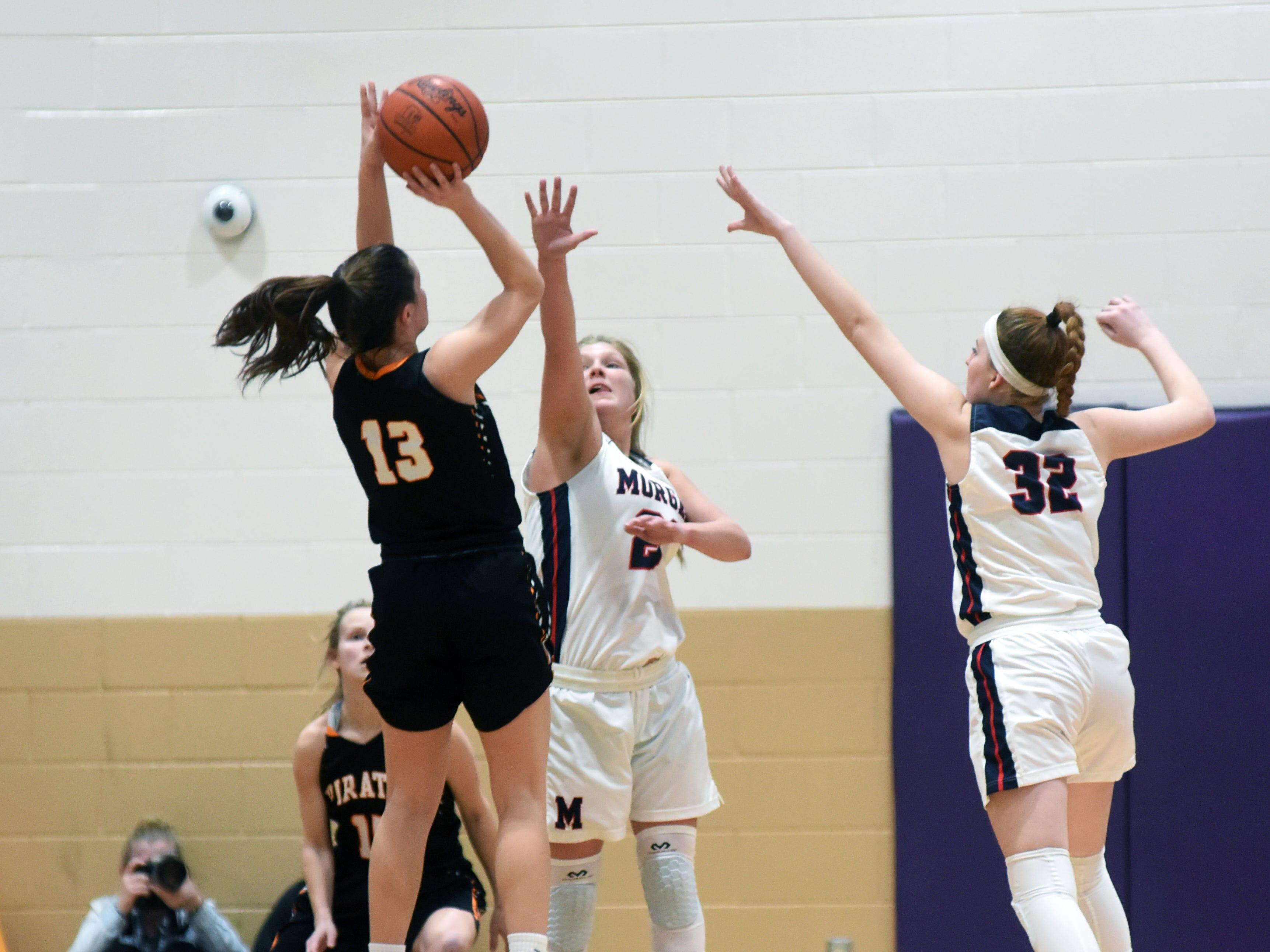 Kara Hopkins tries to block a shot during Morgan's 56-55 loss to Wheelersburg in a Division III regional semifinal at Logan.