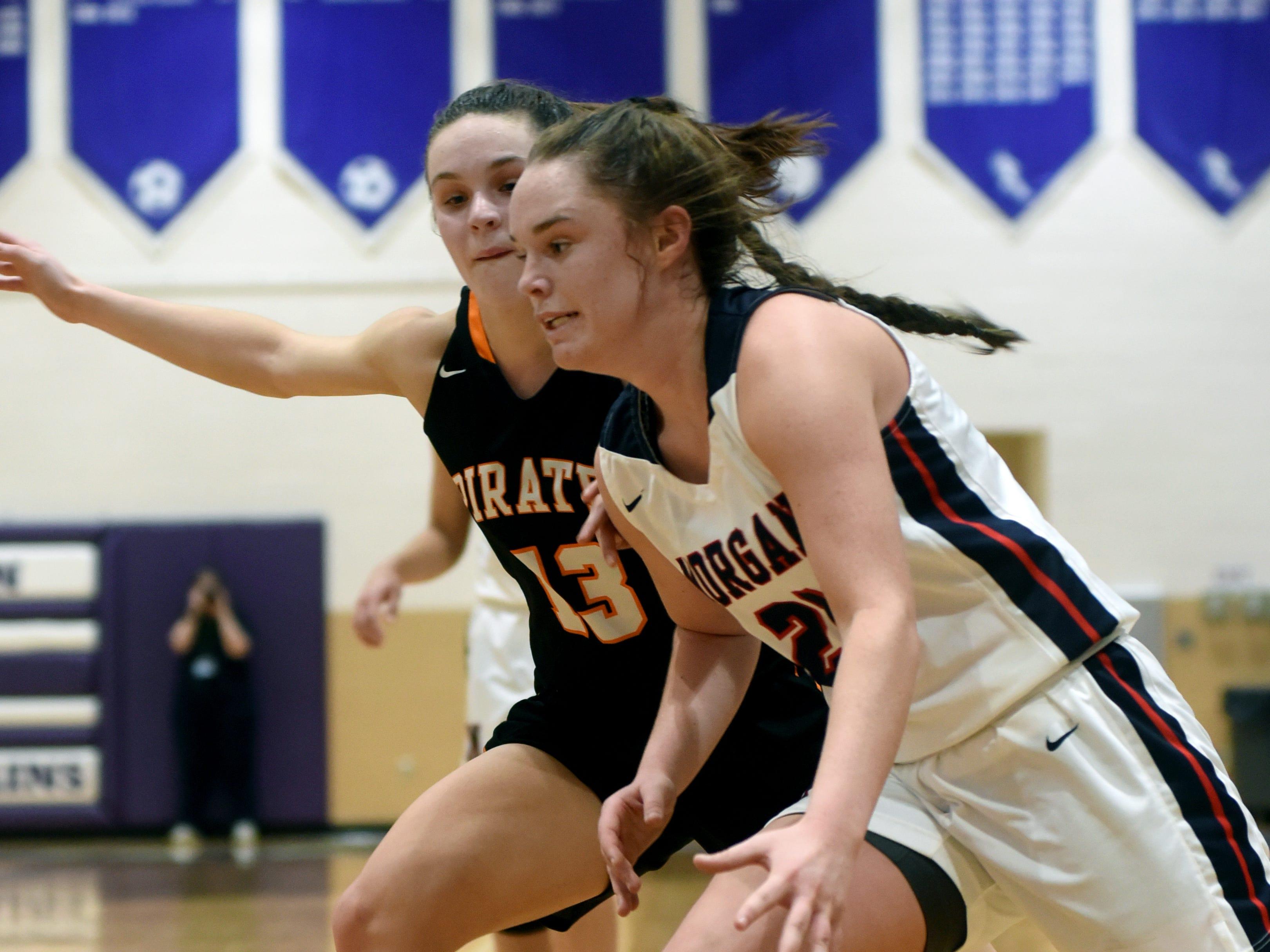 Kaylie Apperon drives the baseline against Wheelersburg's Abbie Kallner during Morgan's 56-55 loss to Wheelersburg in a Division III regional semifinal at Logan.
