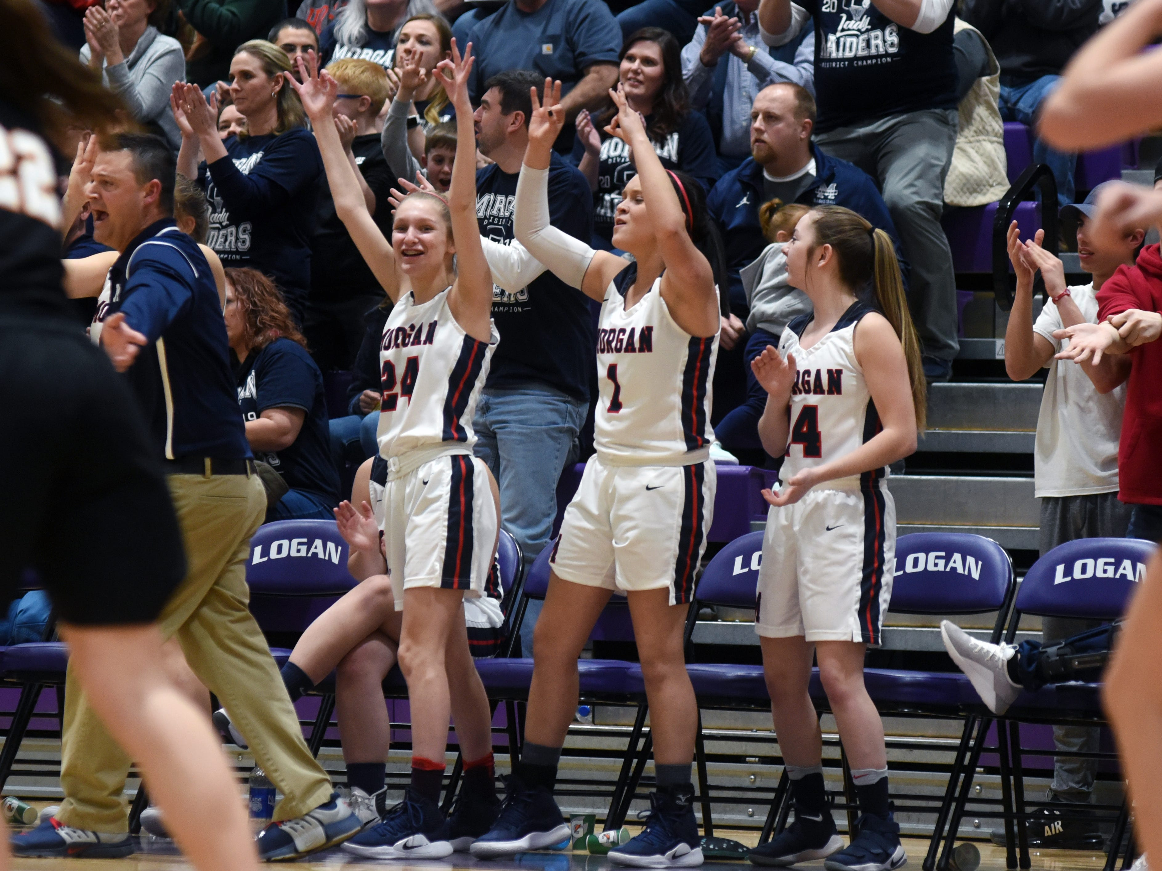 Players on the bench celebrate a 3-pointer during the second half of Morgan's 56-55 loss to Wheelersburg in a Division III regional semifinal at Logan.