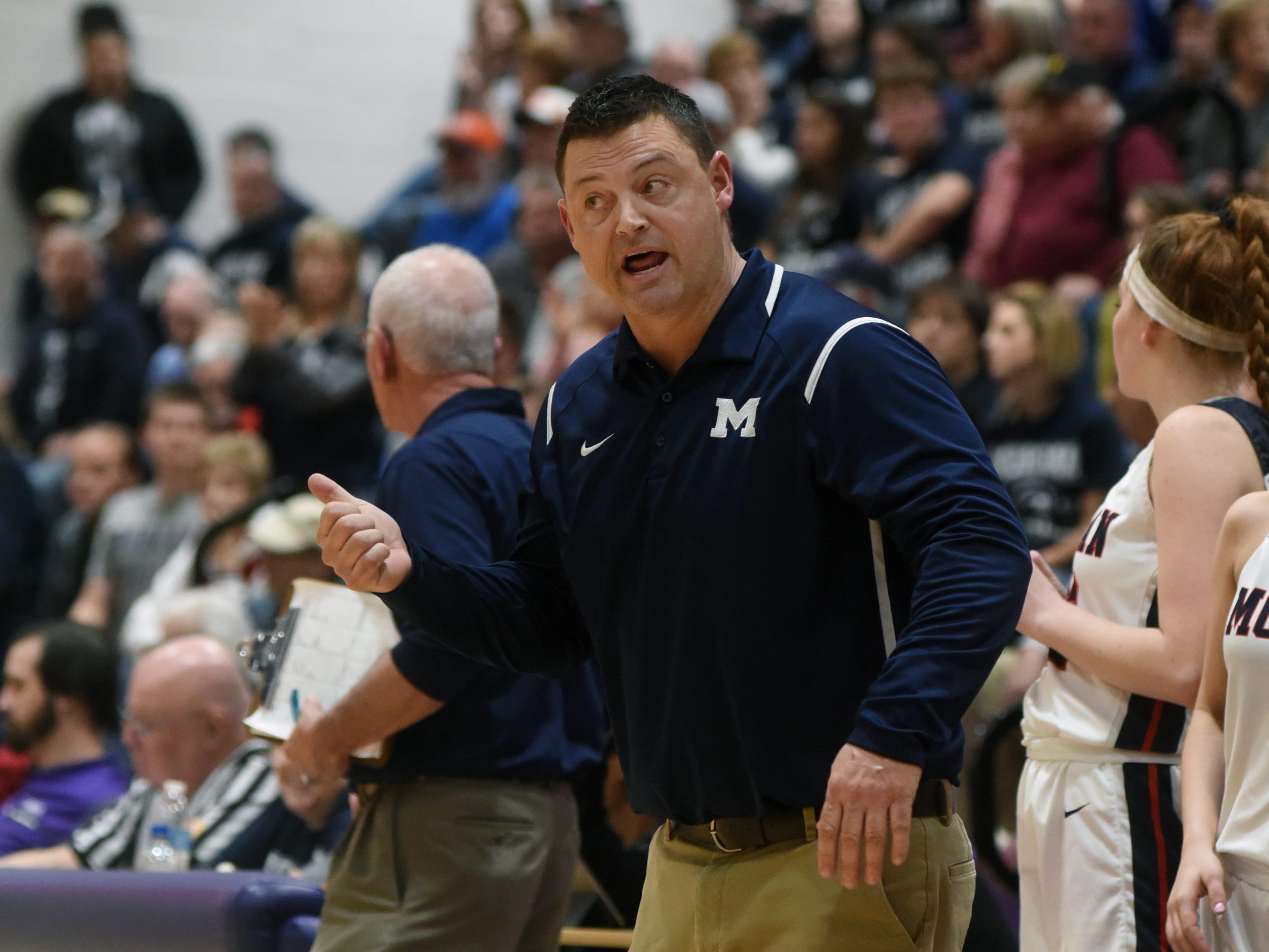 Coach Matt Zumbro talks to his team during the fourth quarter of Morgan's 56-55 loss to Wheelersburg in a Division III regional semifinal at Logan.