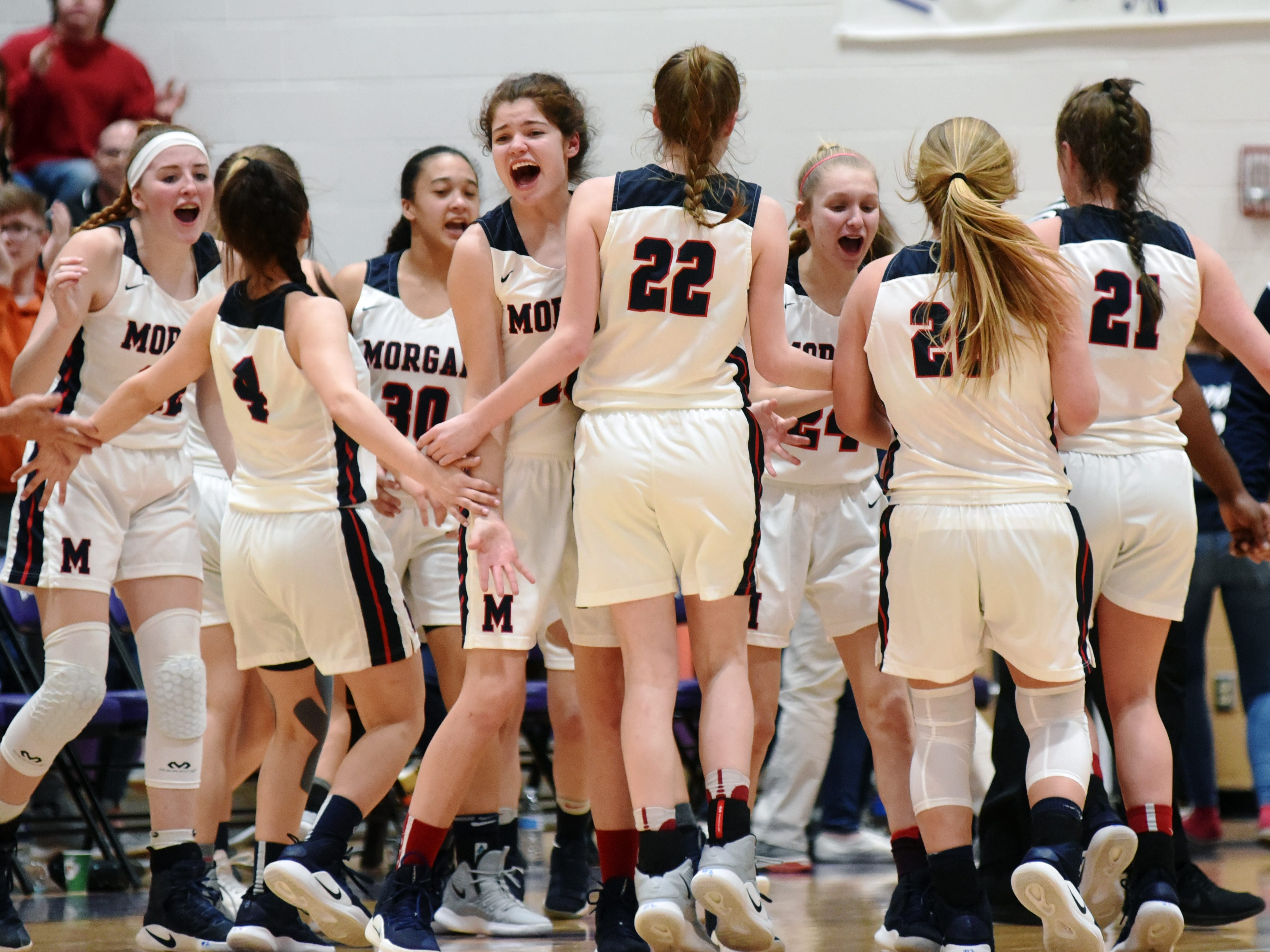 Players celebrate during a timeout in the second quarter of Morgan's 56-55 loss to Wheelersburg in a Division III regional semifinal at Logan.