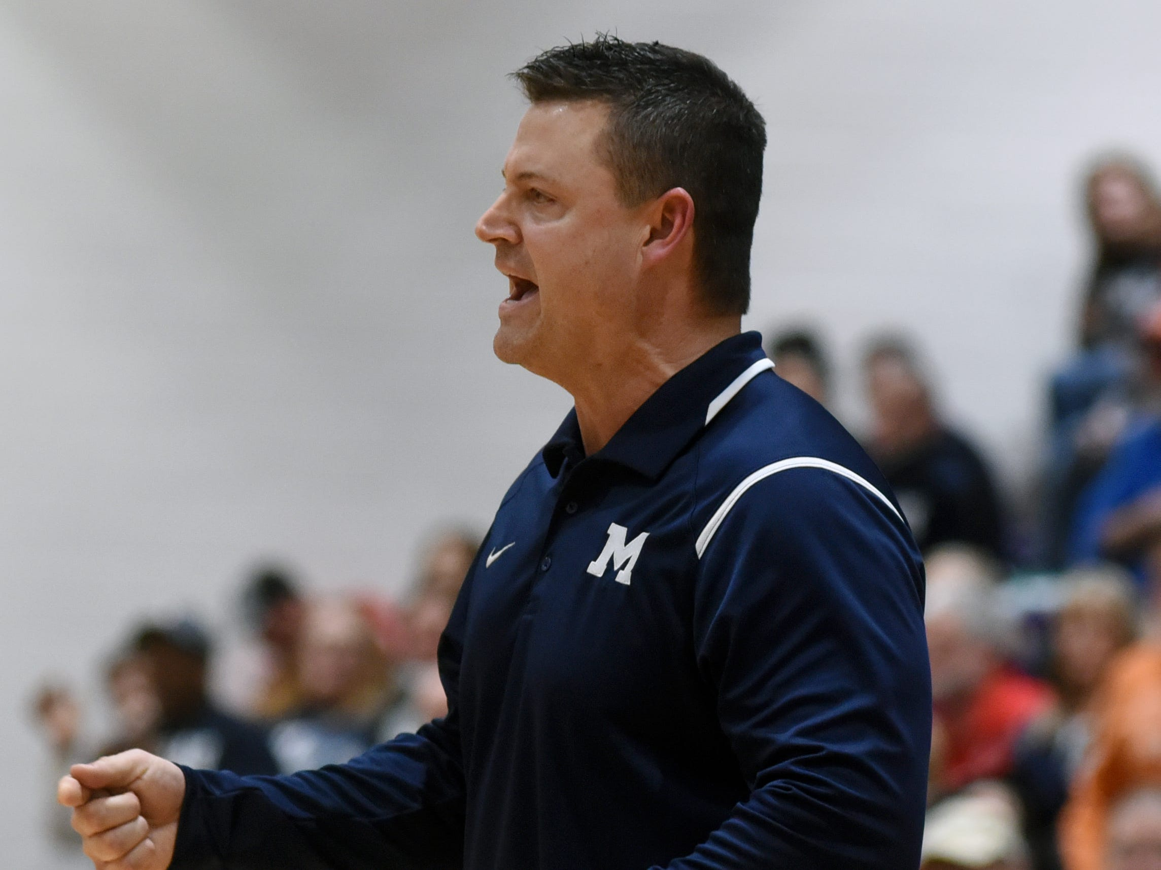 Morgan coach Matt Zumbro tries to get his team's attention during a 56-55 loss to Wheelersburg in a Division III regional semifinal at Logan.