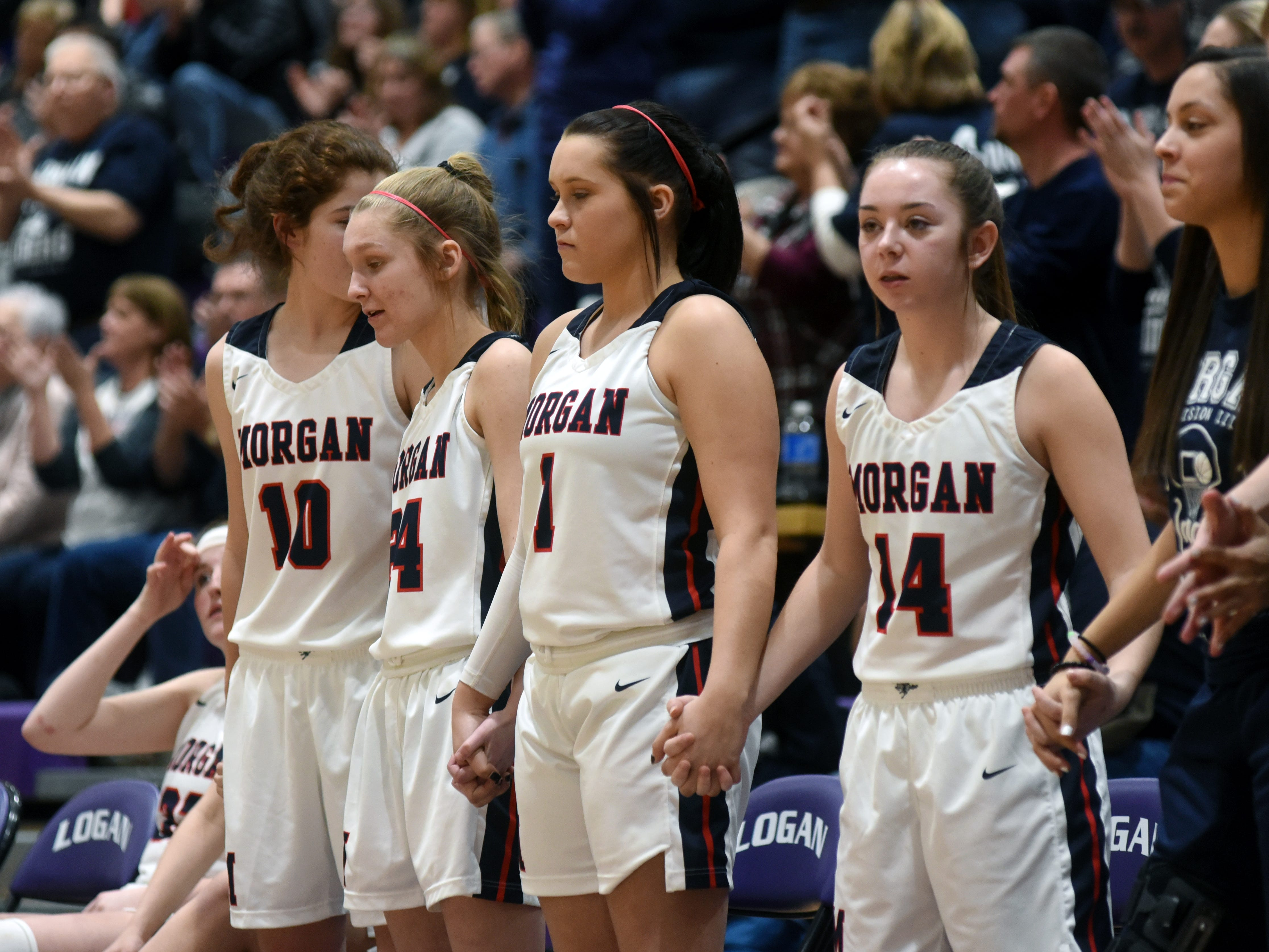 Bench players share a nervous moment in the final minute of Morgan's 56-55 loss to Wheelersburg in a Division III regional semifinal at Logan.