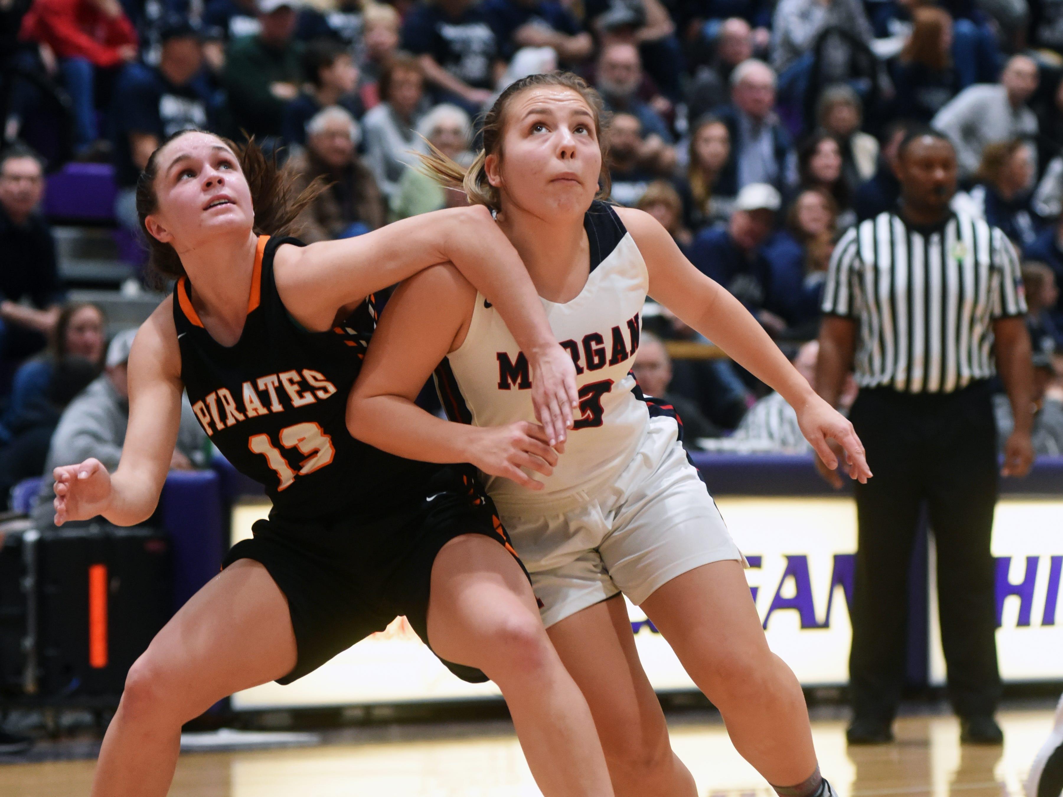 Riley Coon, of Morgan, tries to get rebounding position against Wheelersburg's Abbie Kallner during a Division III regional semifinal at Logan.