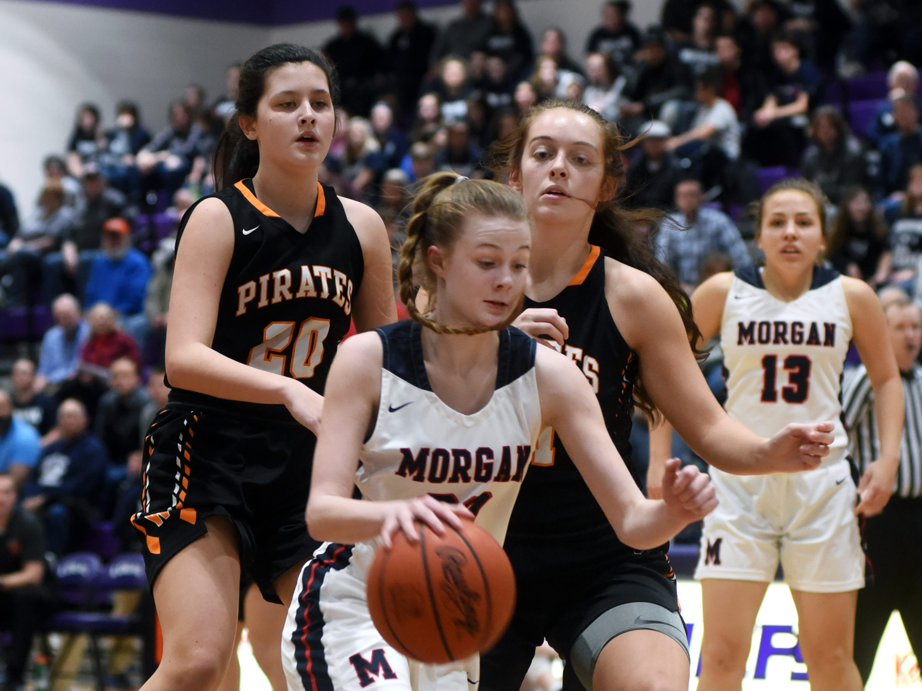 Sophia Smith drives to the basket during Morgan's 56-55 loss to Wheelersburg in a Division III regional semifinal at Logan.