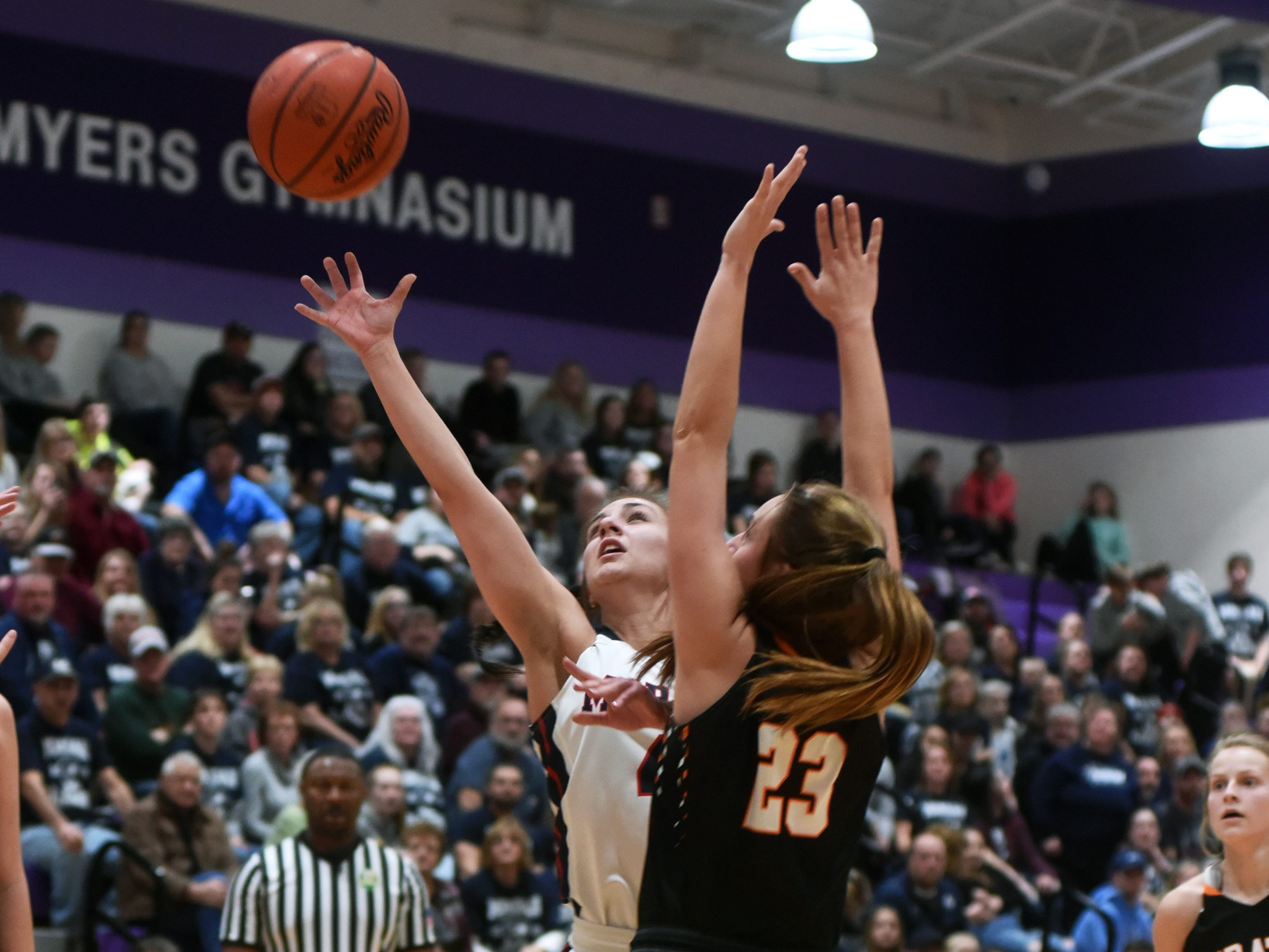 Avery Dilleha goes up for a shot during Morgan's 56-55 loss to Wheelersburg in a Division III regional semifinal at Logan.