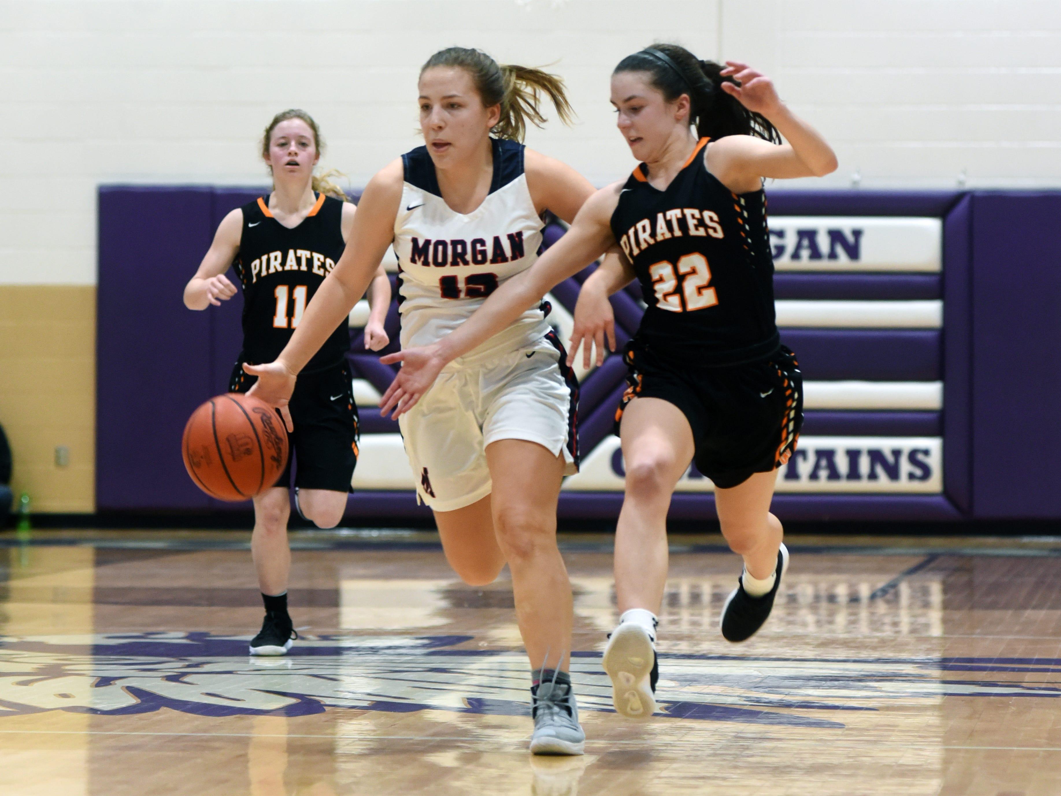 Riley Coon dribbles past Wheelersburg's Ellie Kallner during Morgan's 56-55 loss to Wheelersburg in a Division III regional semifinal at Logan.