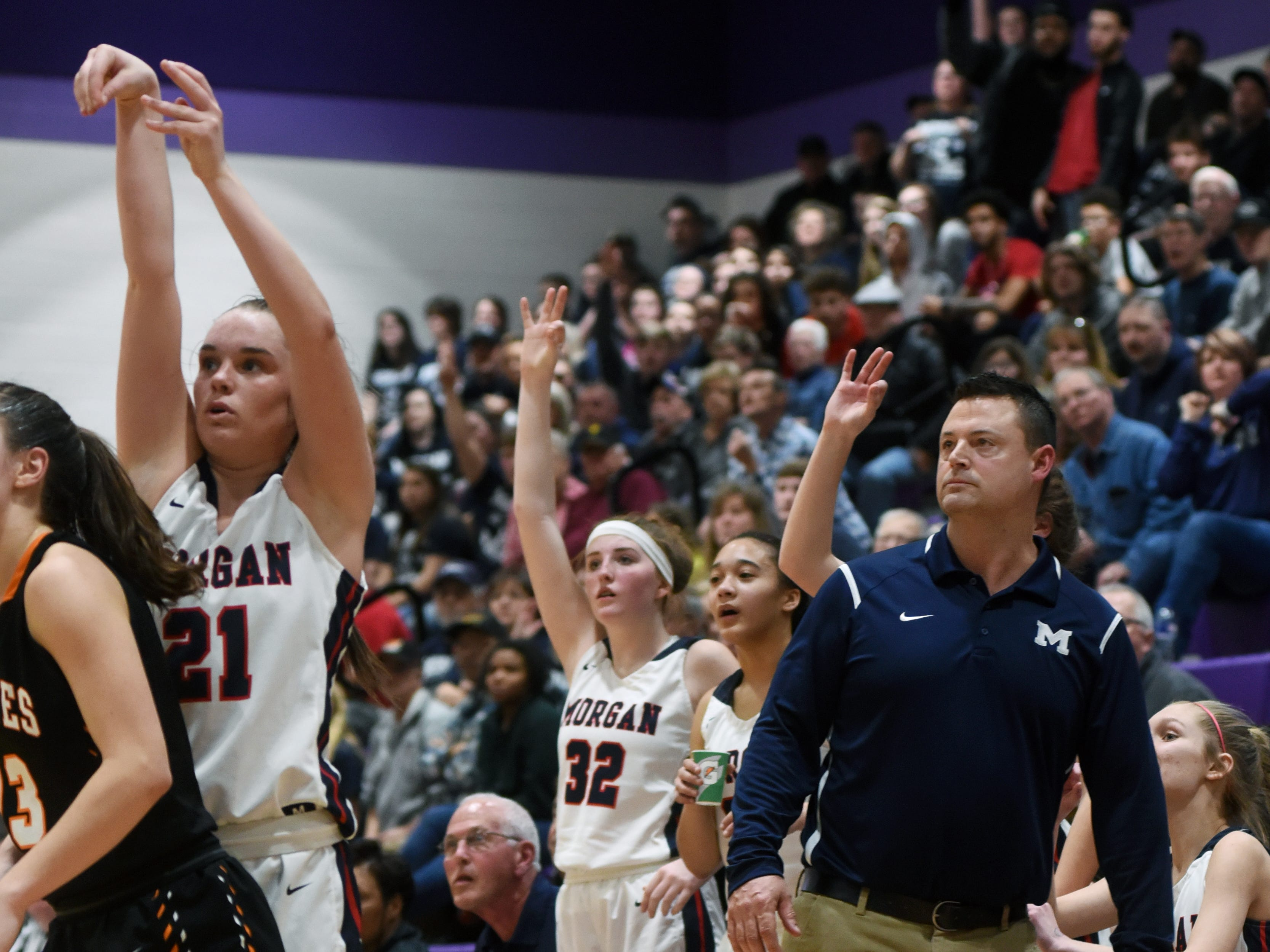 Players on the bench watch Kaylie Apperson's 3-point attempt in the fourth quarter of Morgan's 56-55 loss to Wheelersburg in a Division III regional semifinal at Logan.