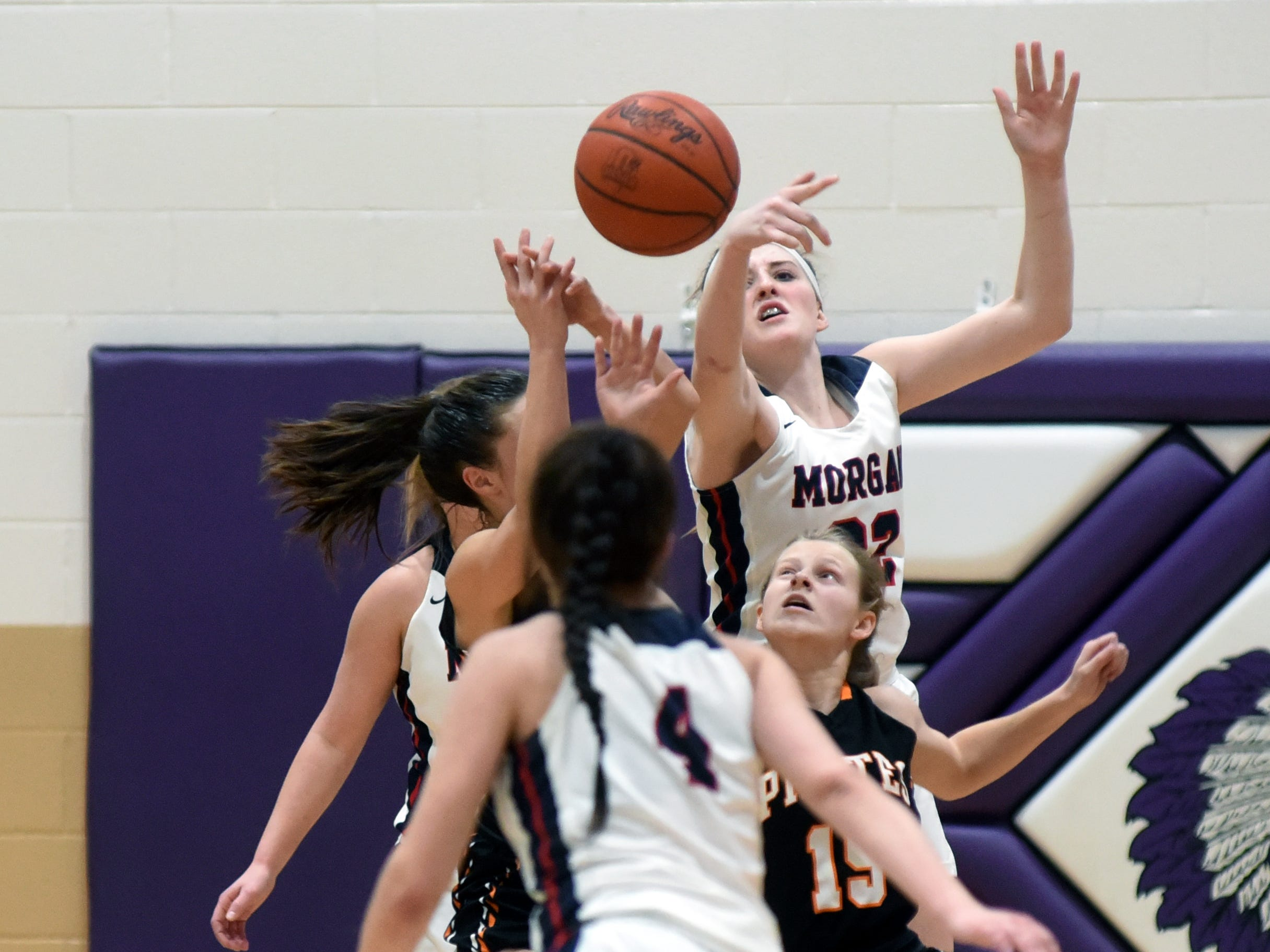 Players fight for a rebound during Morgan's 56-55 loss to Wheelersburg in a Division III regional semifinal at Logan.
