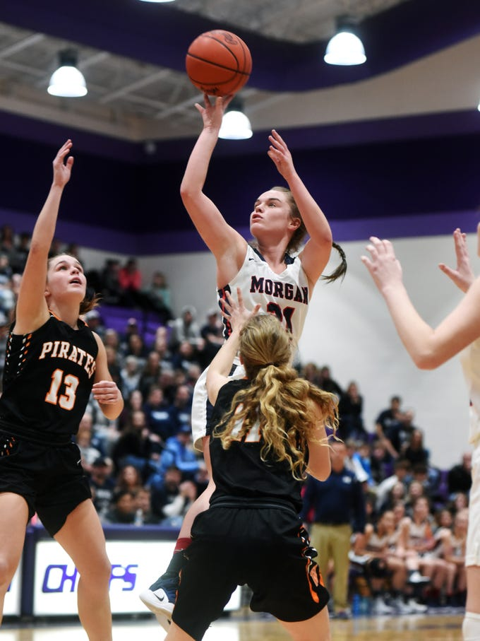 Kaylie Apperson puts up a shot in the first half during Morgan's 56-55 loss to Wheelersburg in a Division III regional semifinal at Logan.