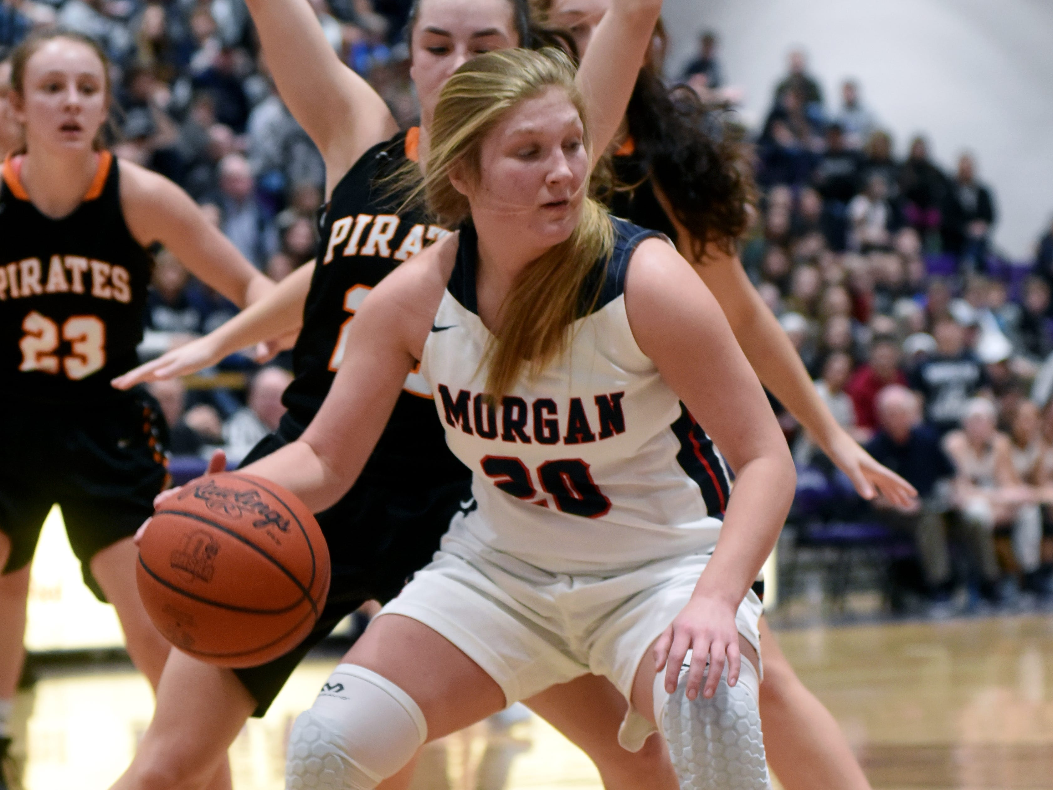 Kara Hopkins works her way into the paint during Morgan's 56-55 loss to Wheelersburg in a Division III regional semifinal at Logan.