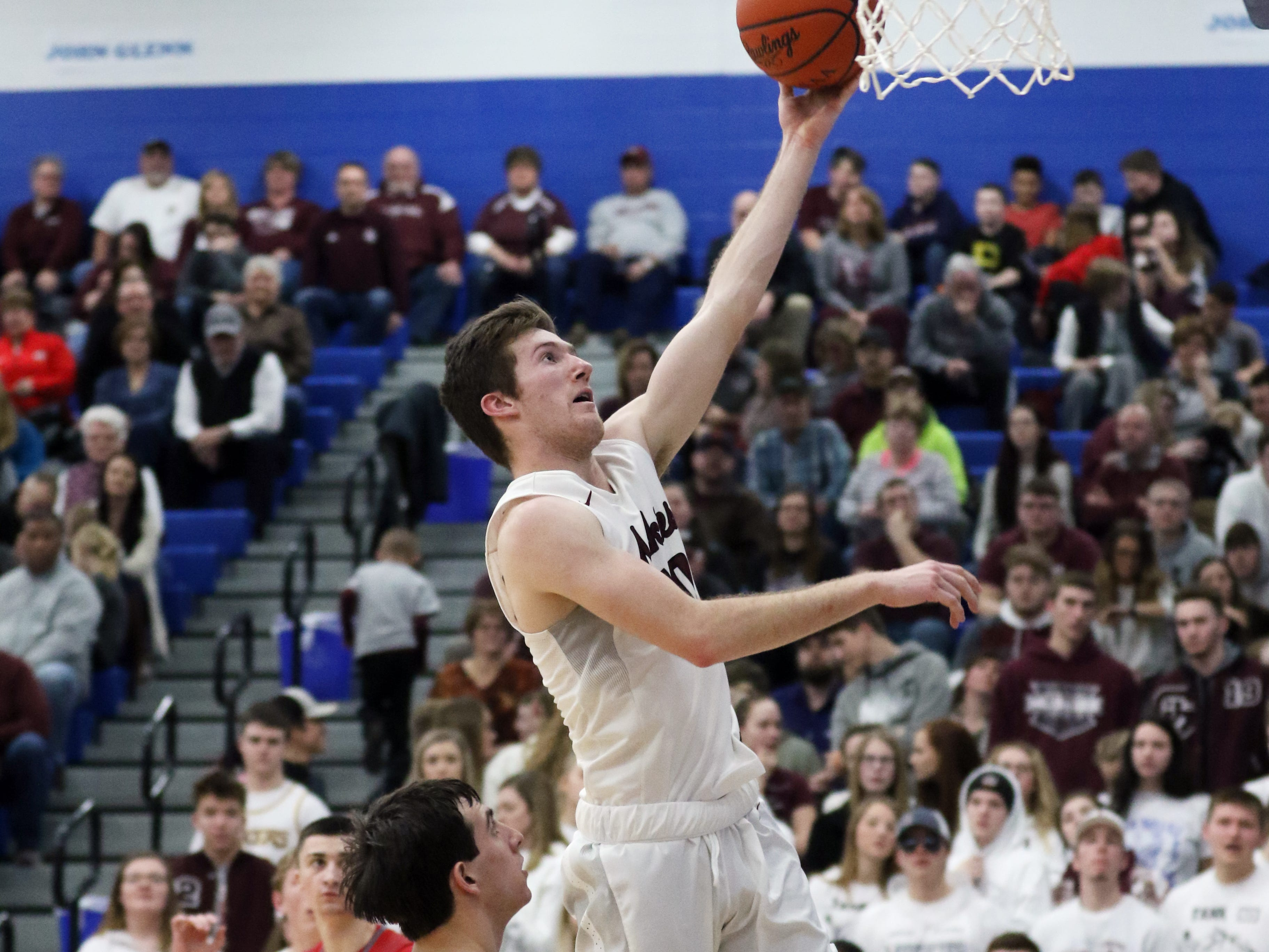 John Glenn's Josh Raley puts up a shot against St. Clairsville late in the Muskies' 70-52 win over the Red Devils at Cambridge High School Wednesday night.