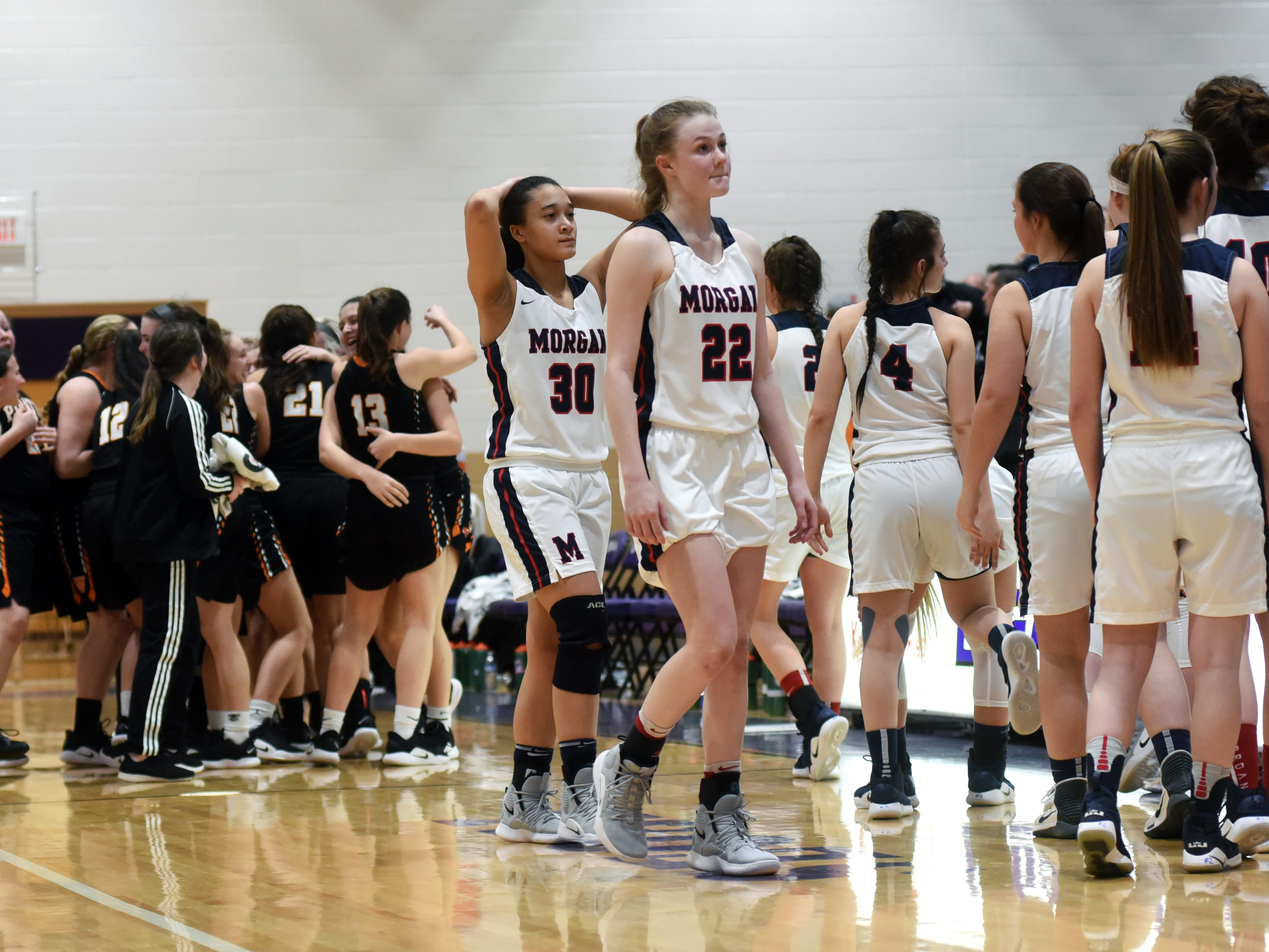 Morgan's players walk off the floor following a 56-55 loss to Wheelersburg in a Division III regional semifinal at Logan.
