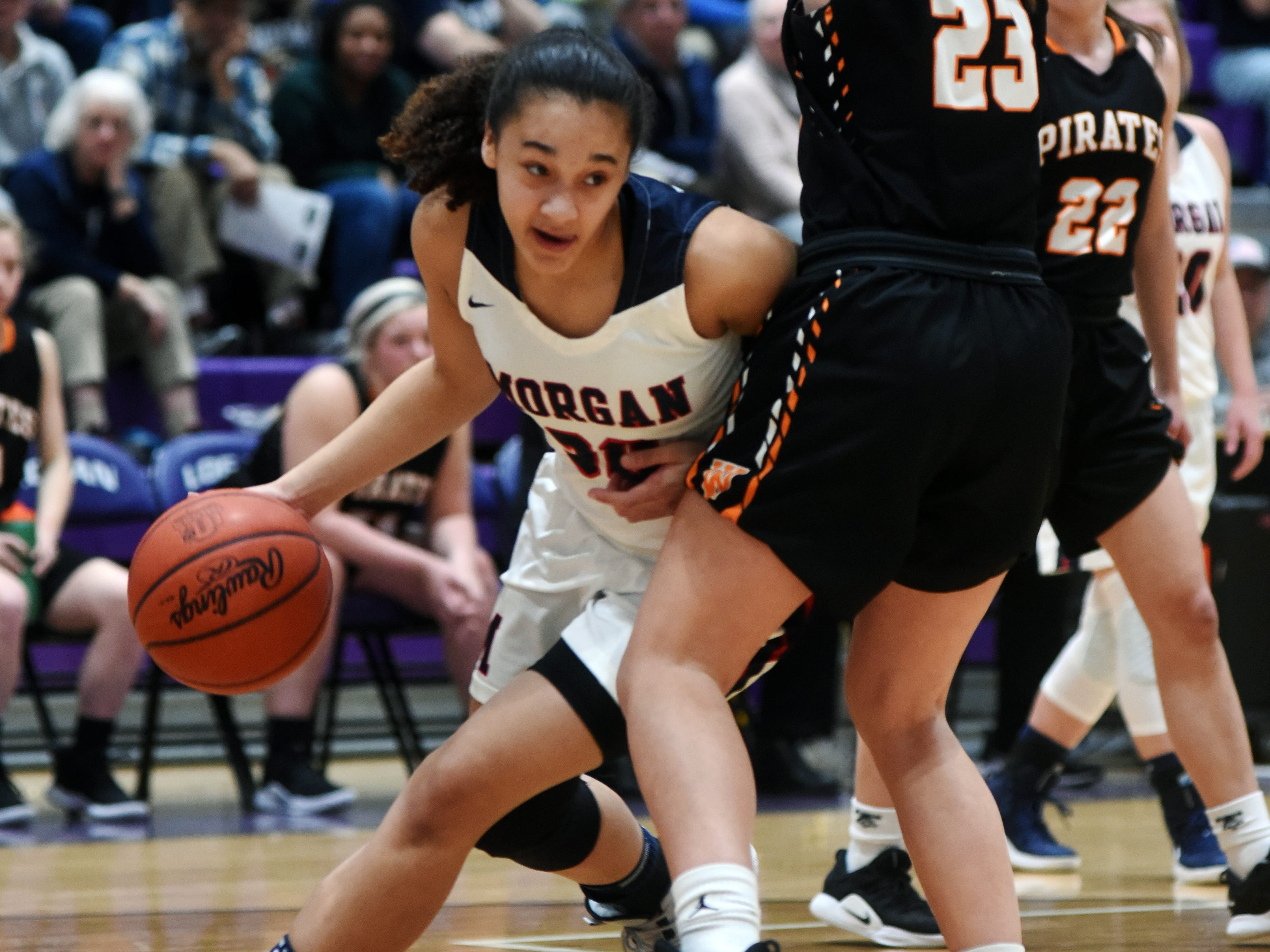 Heaven Williams tries to maneuver around Kaylee Darnell during Morgan's 56-55 loss to Wheelersburg in a Division III regional semifinal at Logan.