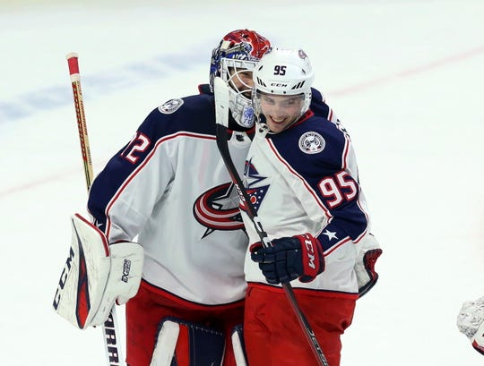 Blue Jackets forward Matt Duchene (95) celebrates with goaltender Sergei Bobrovsky (72) after a win.