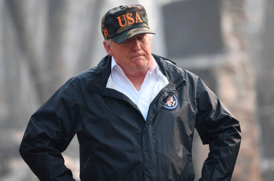 "US President Donald Trump looks on as he views damage from wildfires in Paradise, California on November 17, 2018. - President Donald Trump arrived in California to meet with officials, victims and the ""unbelievably brave"" firefighters there, as more than 1,000 people remain listed as missing in the worst-ever wildfire to hit the US state. (Photo by SAUL LOEB / AFP)SAUL LOEB/AFP/Getty Images ORG XMIT: Trump vis ORIG FILE ID: AFP_1AX5BF"