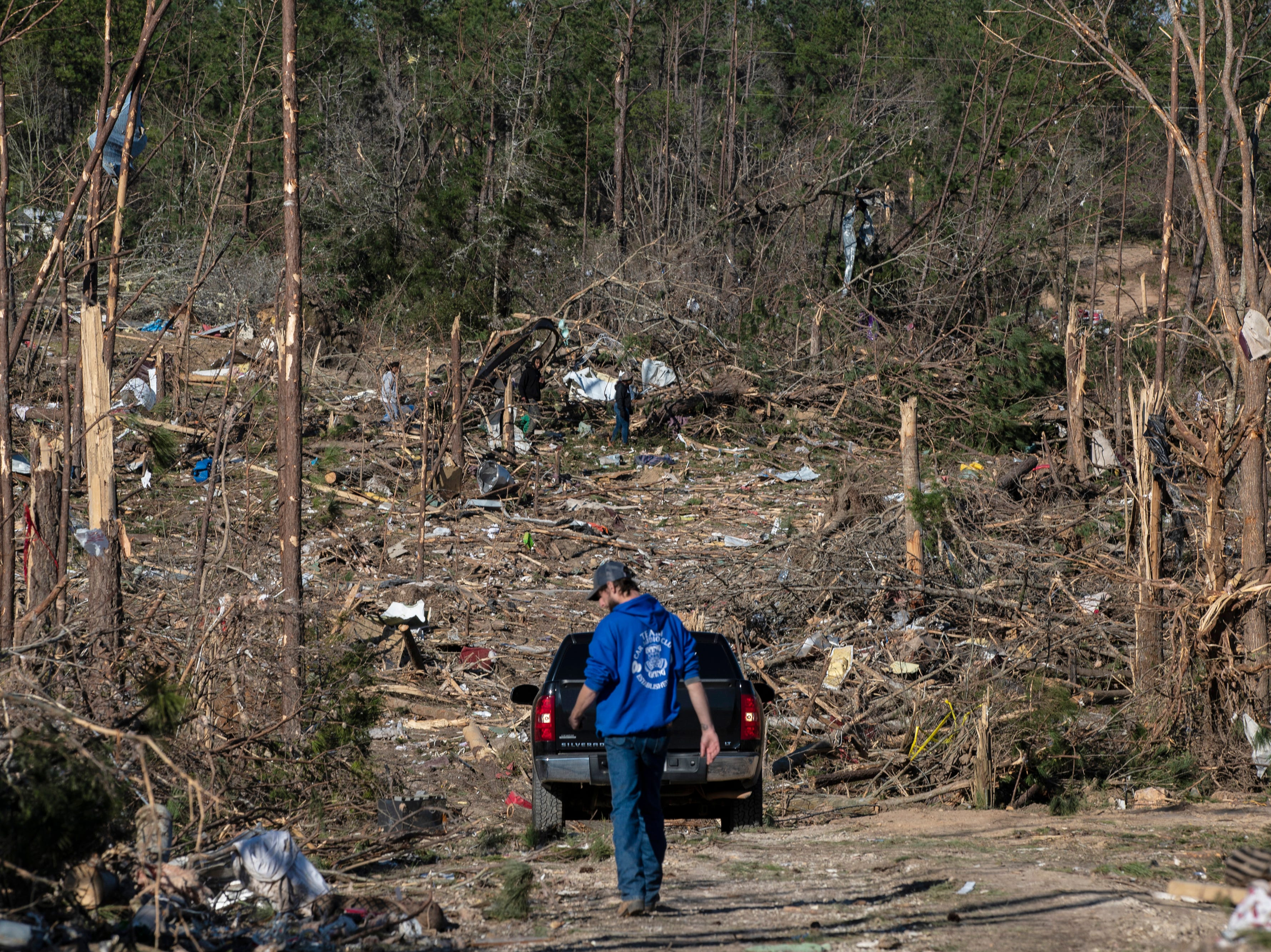 Residents look for items in the debris left in Beauregard, Ala. on March 6, 2019.