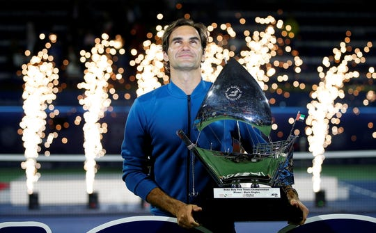 Roger Federer celebrates after winning the Dubai Duty Free Tennis Championships on March 2.