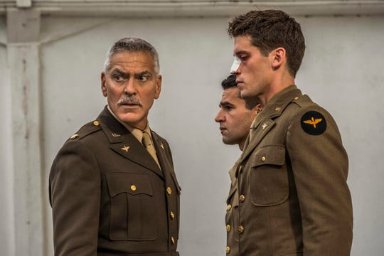 "Scheisskopf (George Clooney), Yossarian (Christopher Abbott), and Clevinger (Pico Alexander) in ""Catch-22."""