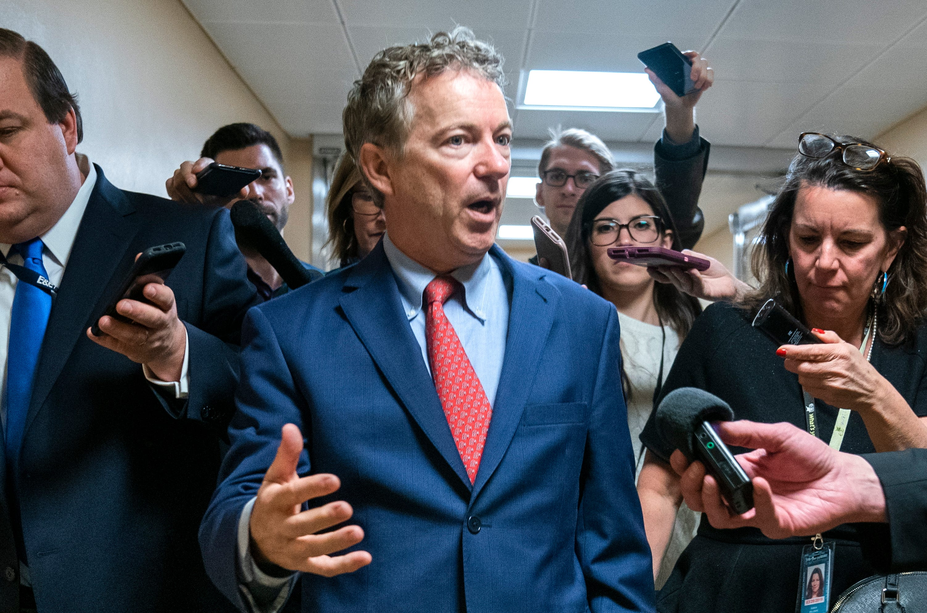 Sen. Rand Paul, R-Ky., who has declared his opposition to approving President Trump's border emergency declaration, walks to a Republican luncheon in the Capitol in Washington, March 4, 2019.