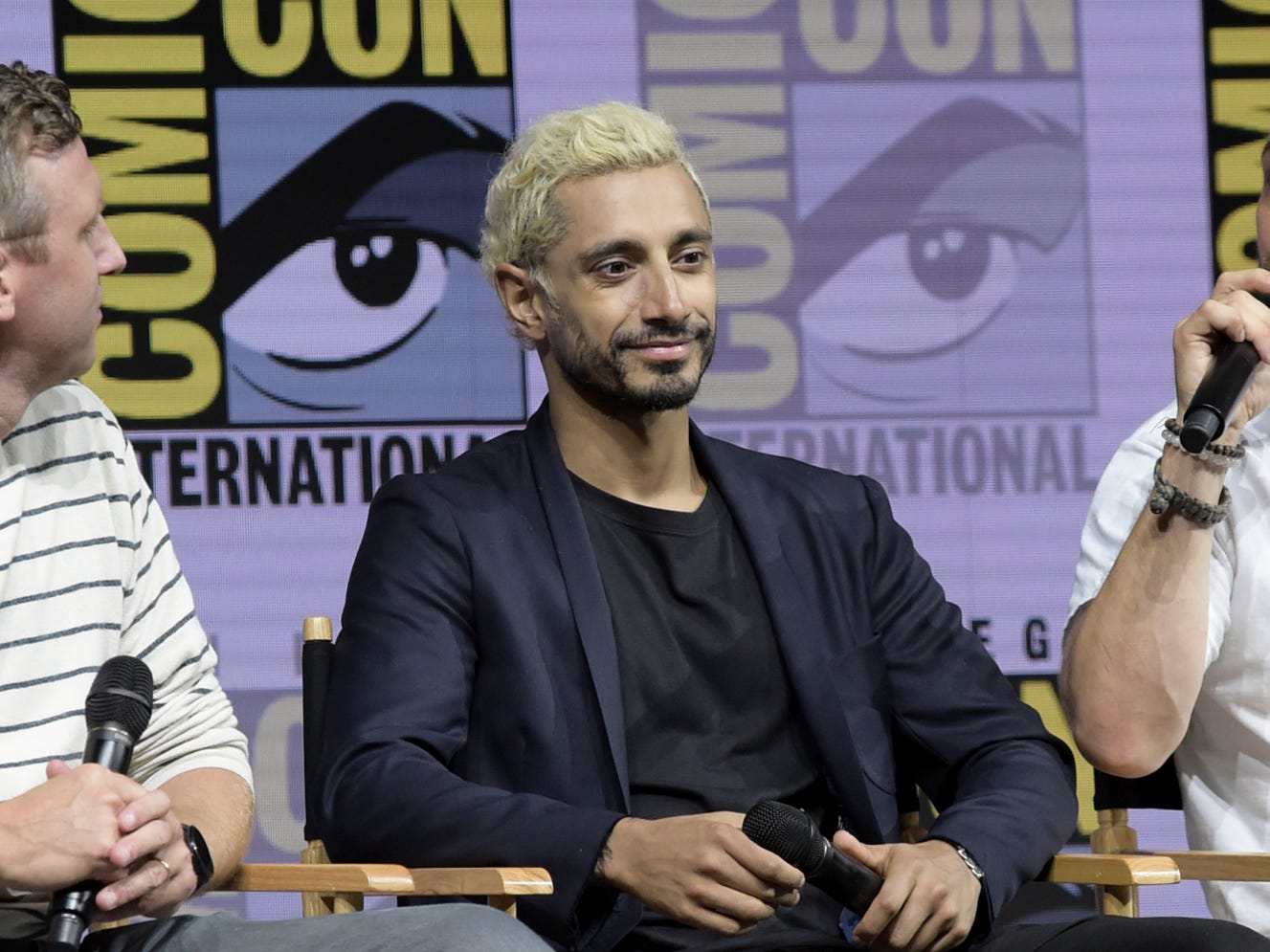 "Ruben Fleischer, from left, Riz Ahmed and Tom Hardy attend the ""Venom"" panel on day two of Comic-Con International on Friday, July 20, 2018, in San Diego. (Photo by Richard Shotwell/Invision/AP) ORG XMIT: CAPS112"
