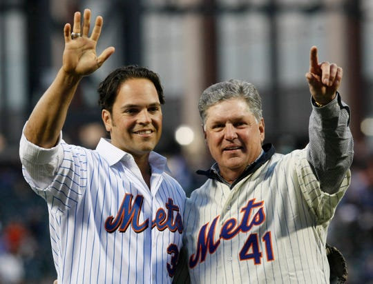 Former New York Mets pitcher Tom Seaver, right, poses with former Mets catcher Mike Piazza after throwing the ceremonial first pitch to open Citi Field in 2009.