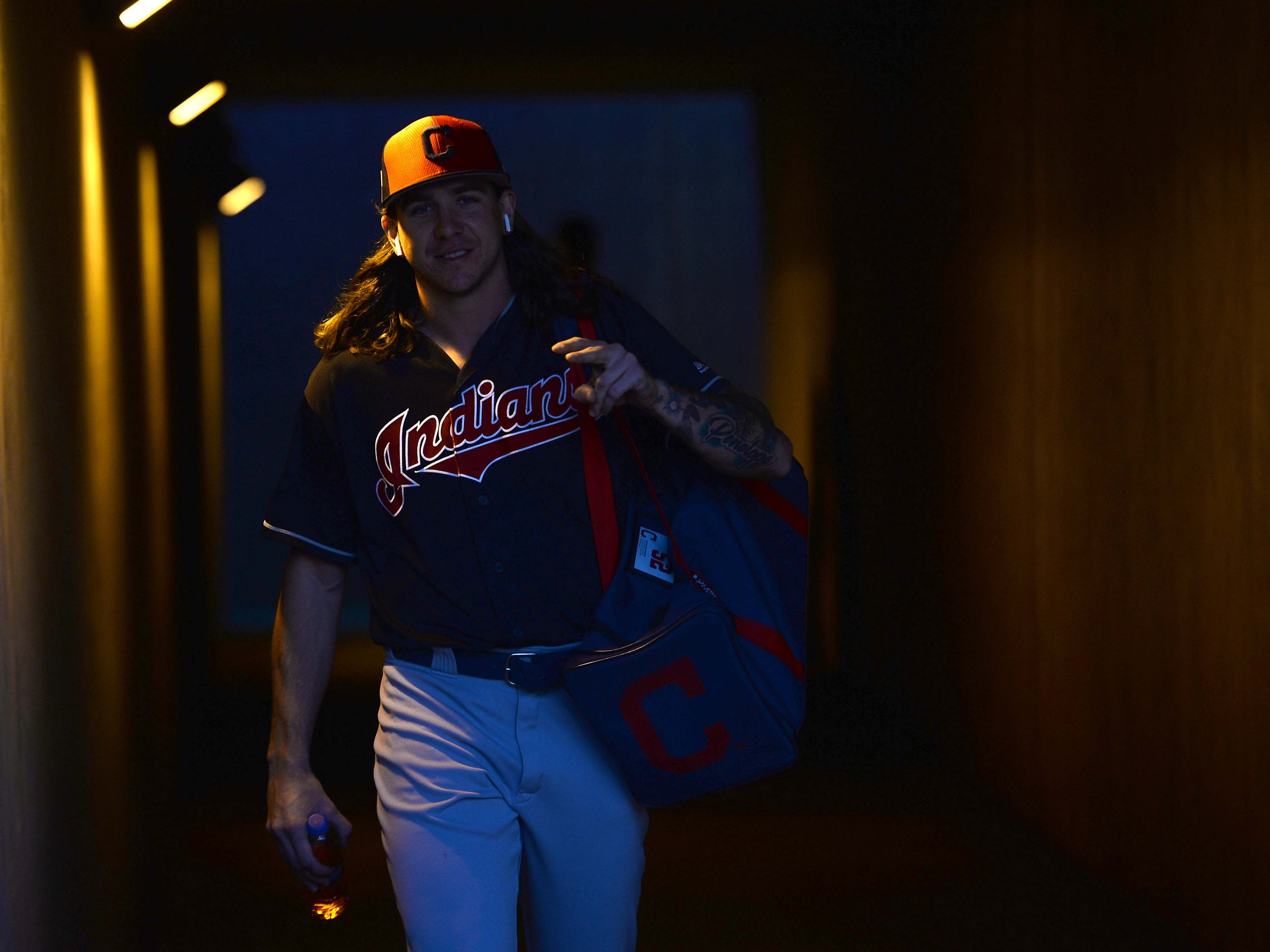 March 6: Indians starting pitcher Mike Clevinger takes the field for warmups.