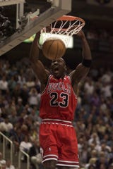 f20101765ce575 Chicago s Michael Jordan dunks during the 1998 NBA Finals Game 2 against  Utah for two of