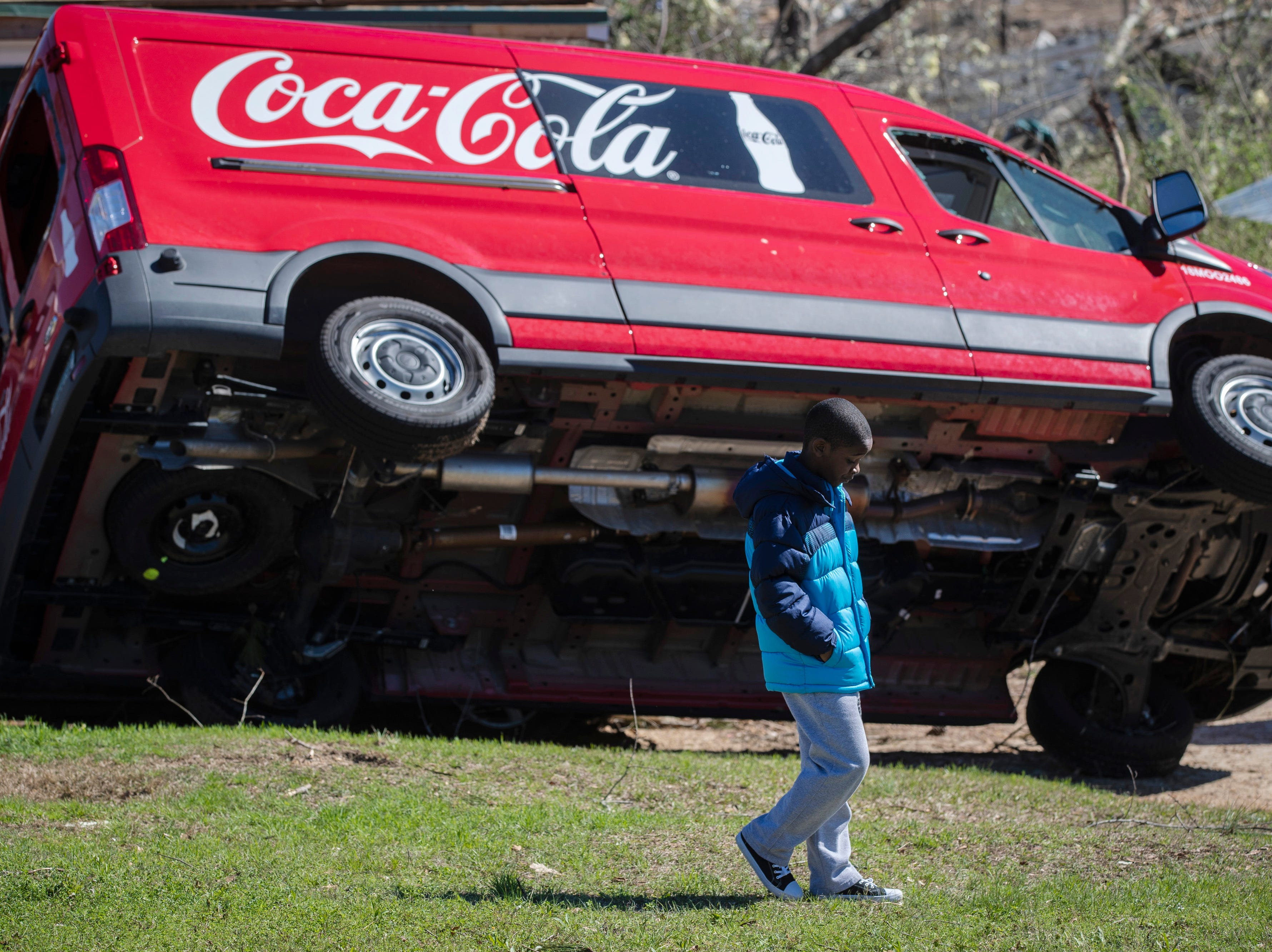 Cameron Baker, 11, walks through his front yard near his father's work truck in Beauregard, Ala. on March 6, 2019.