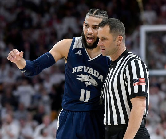 Nevada forward Cody Martin  talks to a referee after getting called for a foul against Utah State during an NCAA college basketball game March 2 in Logan, Utah.