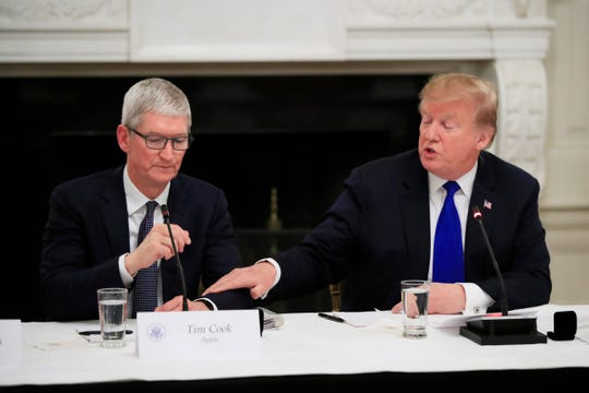 """President Donald Trump acknowledged Apple CEO Tim Cook during the American Workforce Policy Advisory Board Meeting Wednesday. """"Width ="""" 540 """"data-mycapture-src ="""" """"data-mycapture-sm-src ="""""""
