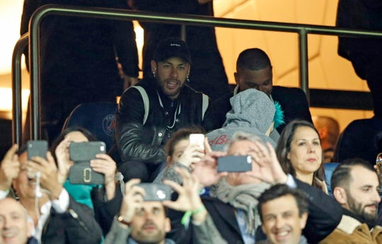 Neymar, who is recovering from injury, watched Paris Saint Germain's elimination from the stands during the UEFA Champions League round of 16 second leg match.