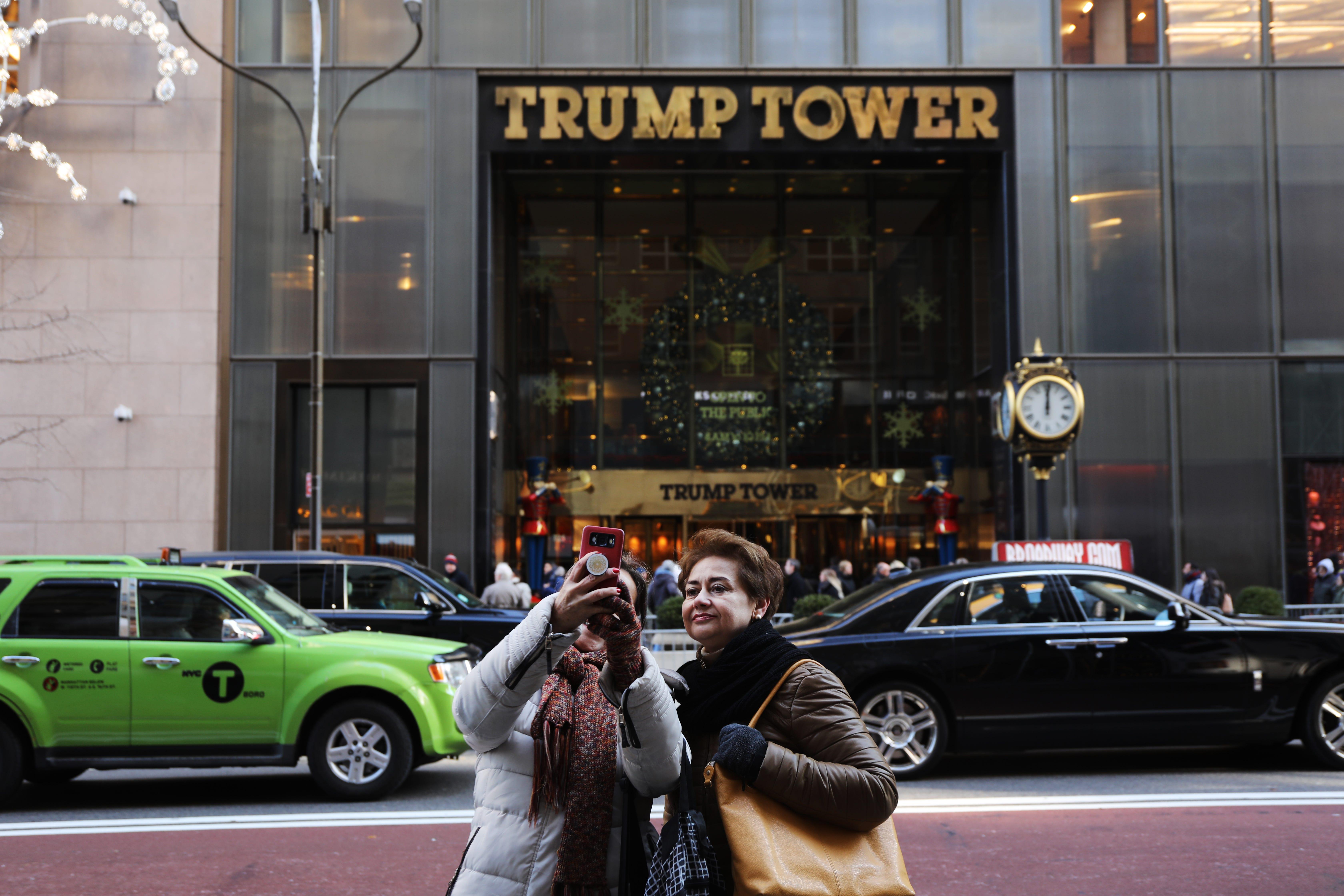 People walk by Trump Tower in Midtown Manhattan on Dec. 10, 2018.