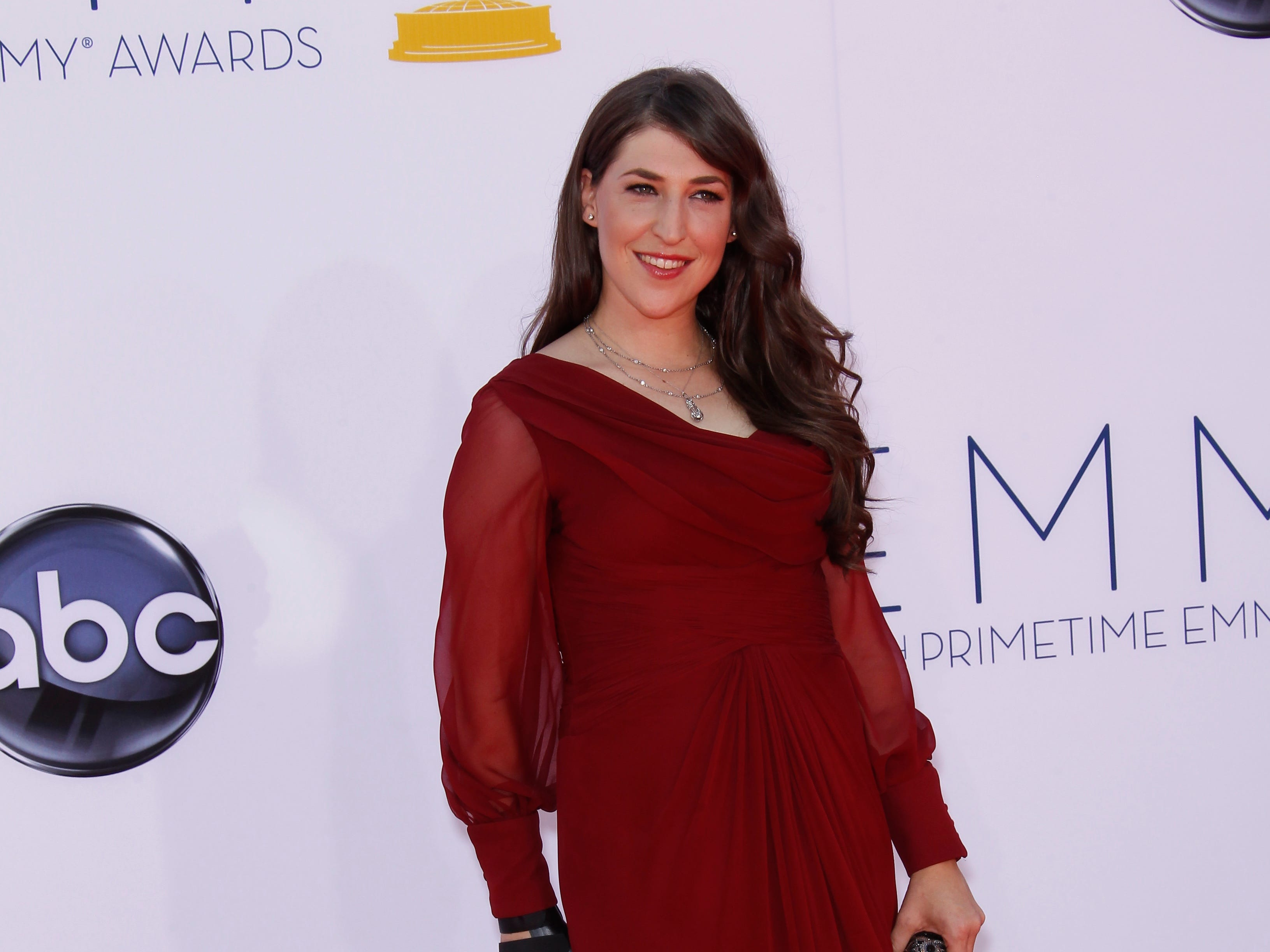 9/23/12 3:18:01 PM -- Los Angeles, CA, U.S.A  -- Mayim Bialik arrives at the 2012 Emmy Awards at the Nokia Theatre in Los Angeles, CA   Photo by Dan MacMedan, USA TODAY contract photographer   ORG XMIT: DM 42420 2012 EMMYS 9/22/2012  (Via OlyDrop)