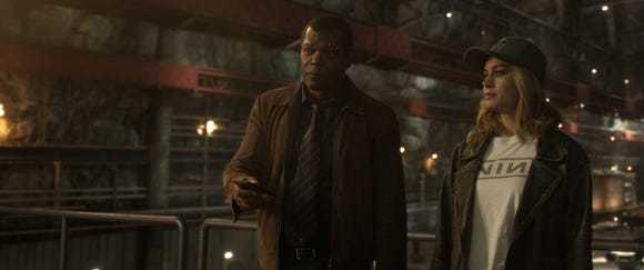 "Nick Fury (Samuel L. Jackson) and Captain Marvel (Brie Larson) team in the past in ""Captain Marvel,"" though he needs her help in the present of ""Avengers: Endgame."""
