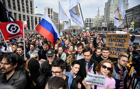 In April 2018, Russians attend an opposition rally in central Moscow to demand internet freedom in Russia.  Authorities tried to block access to the popular messaging app Telegram in the latest onslaught against dissent under Vladimir Putin.