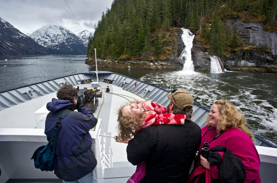 Kris Dorsey, right, her husband, Brian, and their daughter, Emma, 5, enjoys their time out on the deck of the Alaska State Highway ferry Malaspina during it's 50th Anniversary Golden Voyage cruise to Tracy Arm Fjord on Saturday, May 4, 2013, in Southeast Alaska.