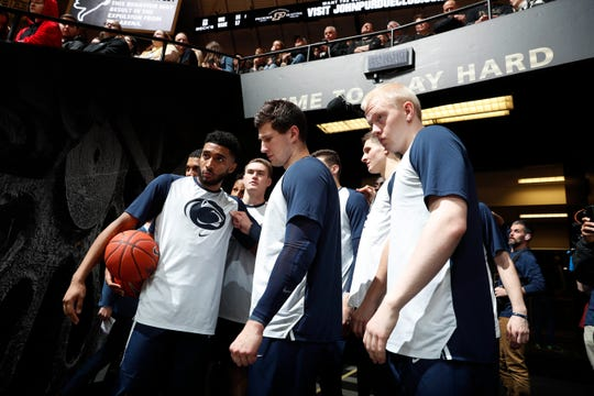Penn State Nittany Lions huddle up in the tunnel before a game.