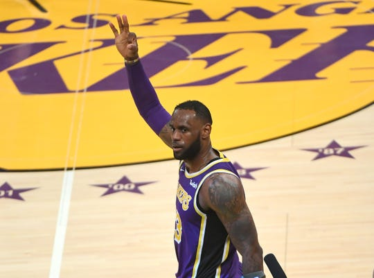 LeBron James acknowledges the crowd at Staples Center.