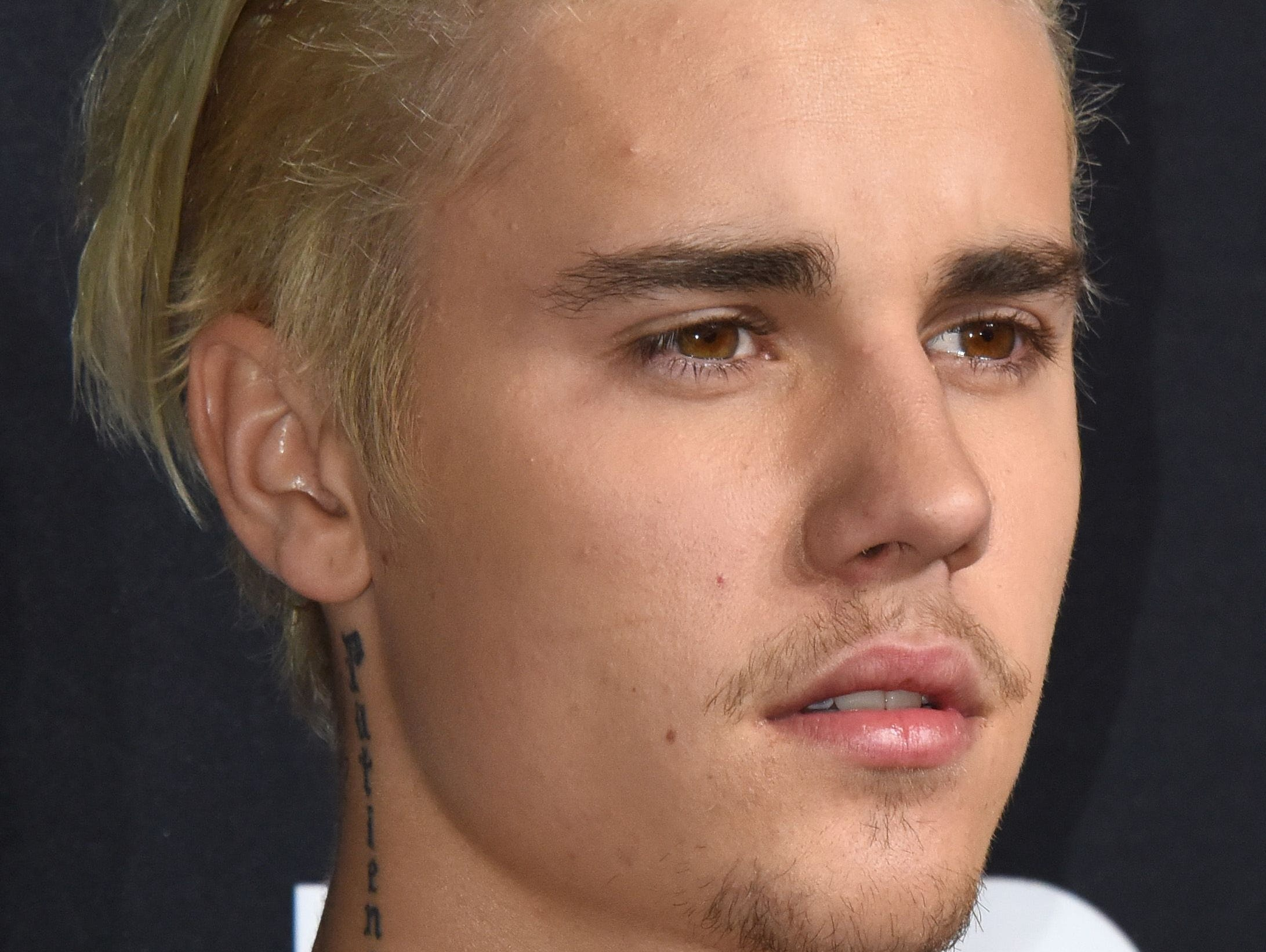 (FILES) A file photo taken on Fenruary 10, 2016, show singer Justin Bieber attending the Yves Saint Laurent men's fall line at the Hollywood Palladium in Hollywood, California.
